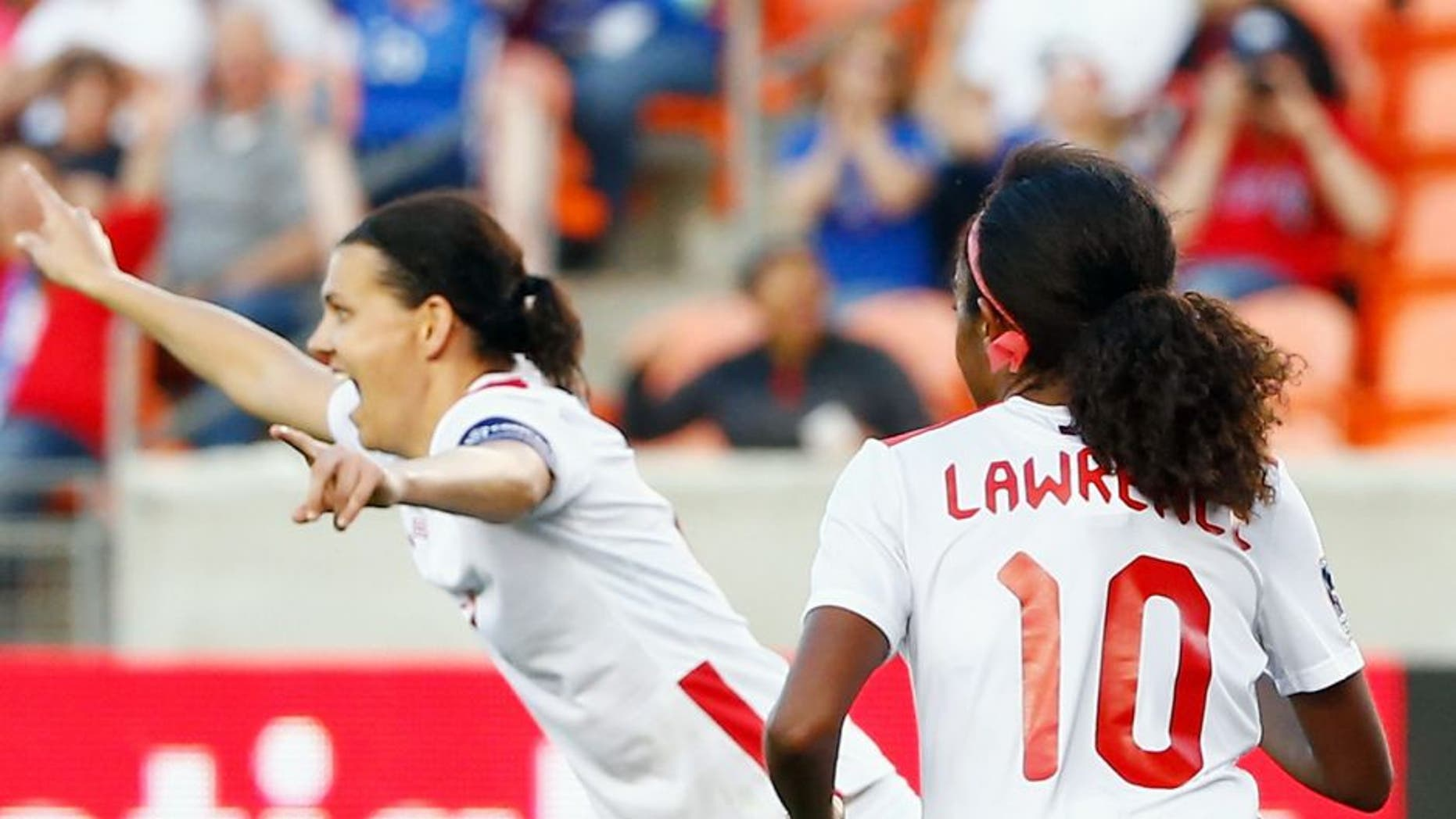 HOUSTON, TX - FEBRUARY 19: Christine Sinclair #12 of Canada celebrates after scoring a second half goal against Costa Rica during the Semifinal of the 2016 CONCACAF Women's Olympic Qualifying at BBVA Compass Stadium on February 19, 2016 in Houston, Texas. (Photo by Scott Halleran/Getty Images)