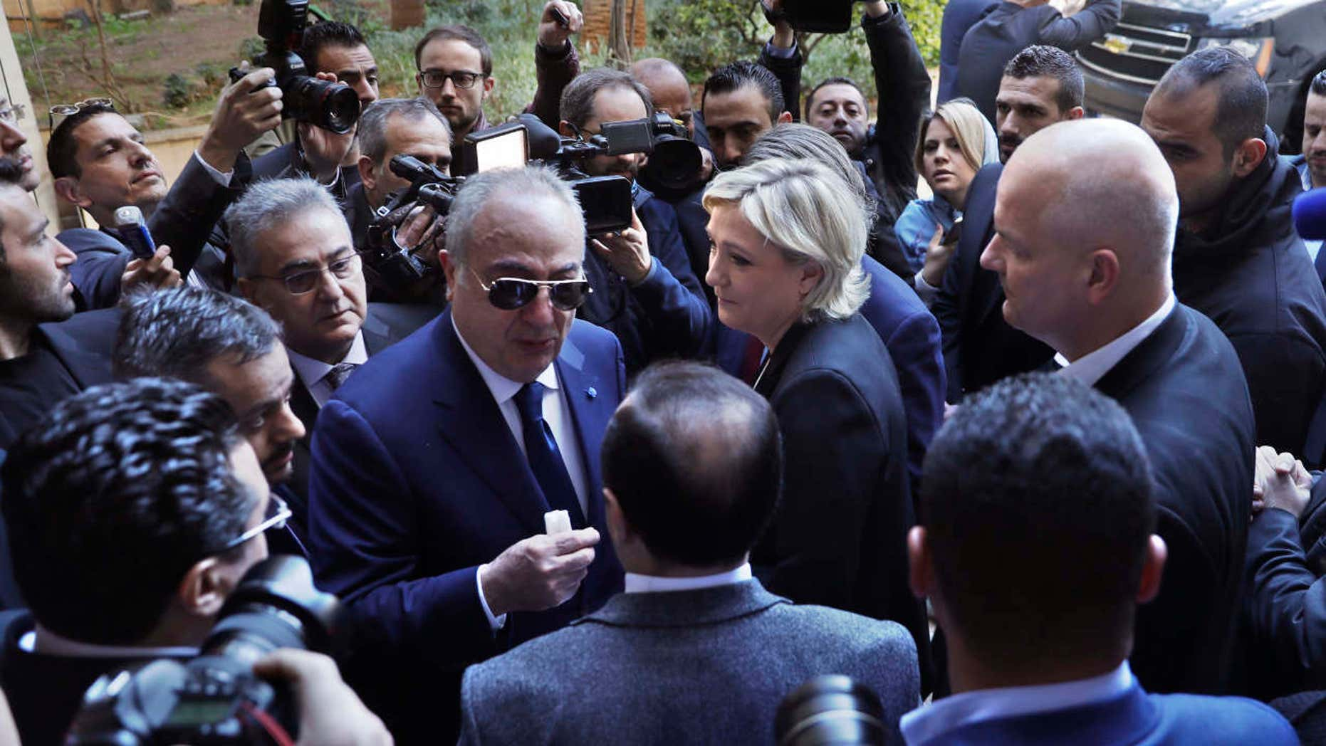French far-right presidential candidate Marine Le Pen, center, leaves Dar al-Fatwa building.