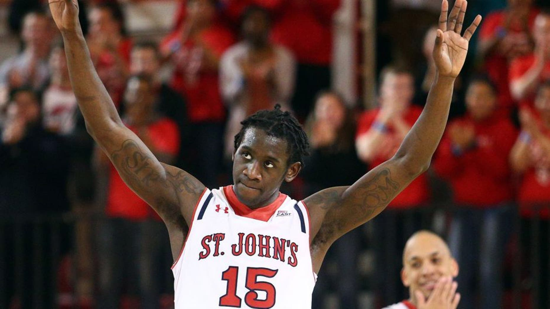 Feb 21, 2015; Jamaica, NY, USA; St. John's Red Storm guard Sir'Dominic Pointer (15) and guard D'Angelo Harrison (11) react during the second half against the Seton Hall Pirates at Carnesecca Arena. Mandatory Credit: Brad Penner-USA TODAY Sports
