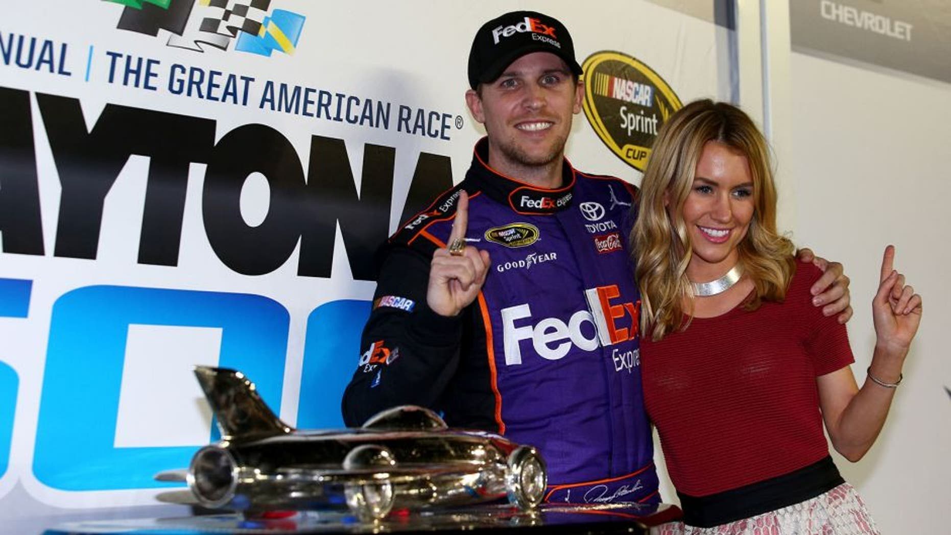 DAYTONA BEACH, FL - FEBRUARY 21: Denny Hamlin, driver of the #11 FedEx Express Toyota, celebrates in Victory Lane with his wife, Jordan Fish after winning the NASCAR Sprint Cup Series DAYTONA 500 at Daytona International Speedway on February 21, 2016 in Daytona Beach, Florida. (Photo by Sarah Crabill/NASCAR via Getty Images)