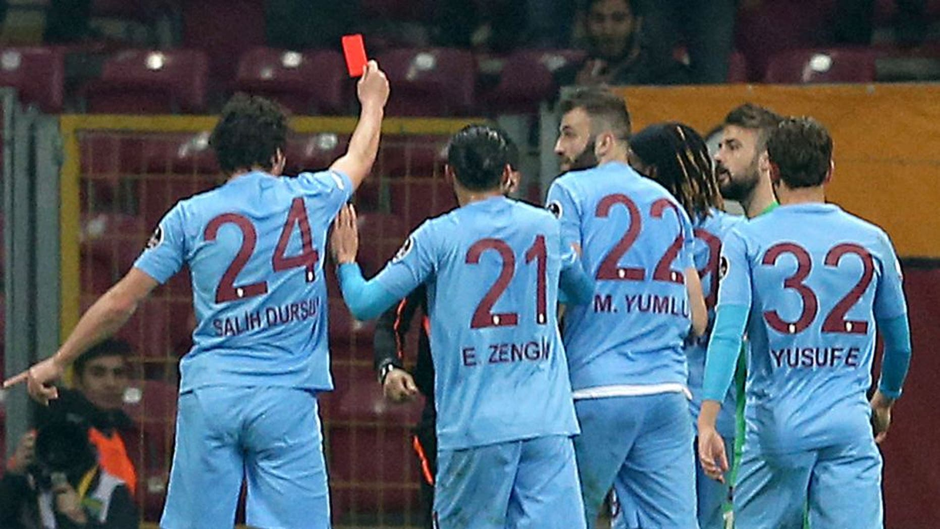 ISTANBUL, TURKEY, FEBRUARY 21: Salih Dursun (24) of Trabzonspor shows a red card to referee as he takes the card from referee's hand to react his decisions during Turkish Spor Toto Super Lig football match between Galatasaray and Trabzon at Turk Telekom Arena in Istanbul, Turkey on February 21, 2016. (Photo by Berk Ozkan/Anadolu Agency/Getty Images)