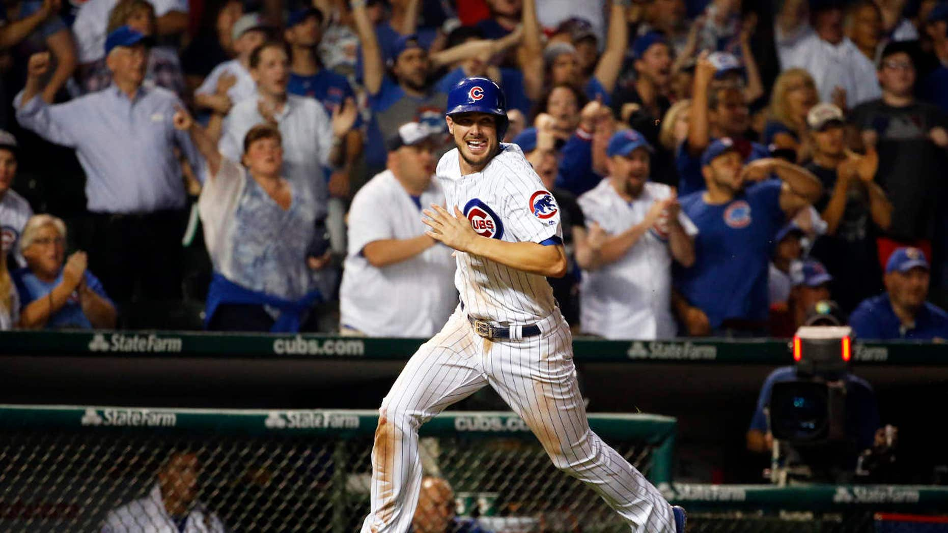 FILE - In this July 7, 2016, file photo, Chicago Cubs' Kris Bryant scores on a single hit by Ben Zobrist during the eighth inning of a baseball game against the Atlanta Braves, in Chicago.