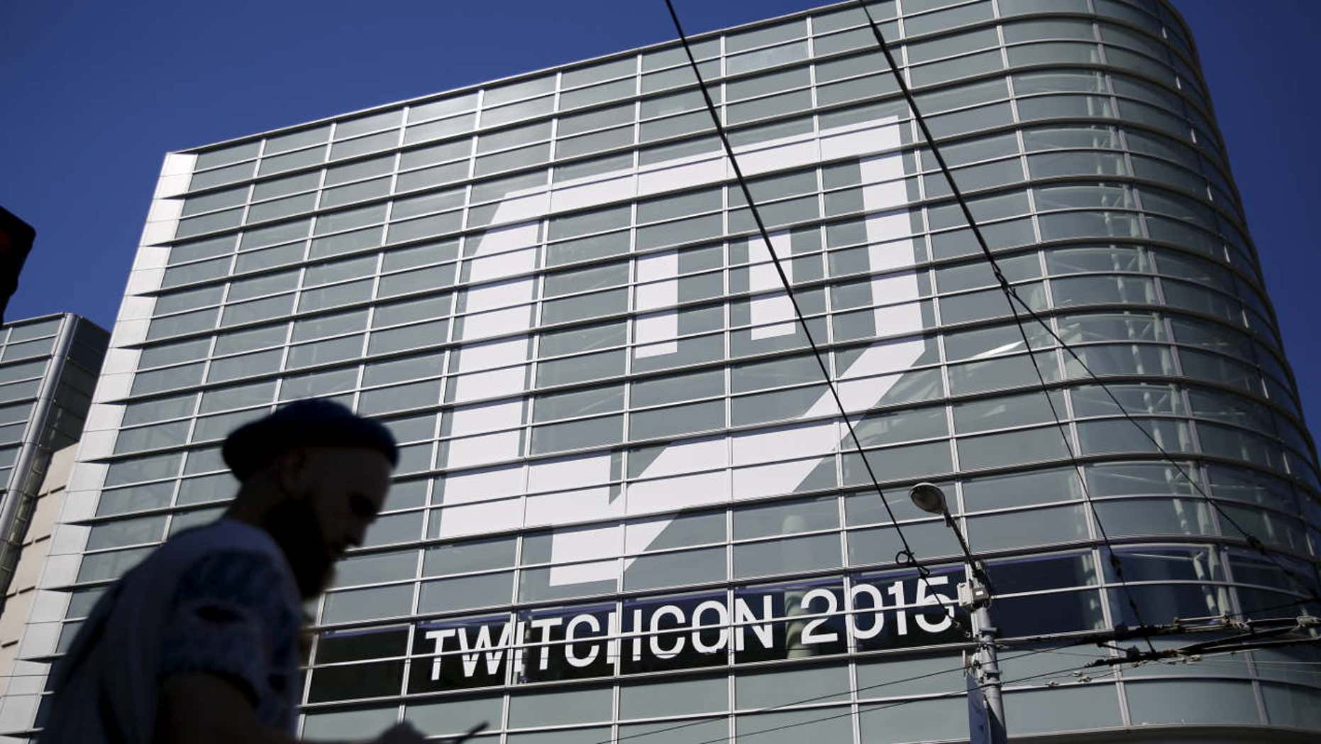 Sept. 25, 2015: A man works with a mobile device prior to entering TwitchCon 2015 in San Francisco.