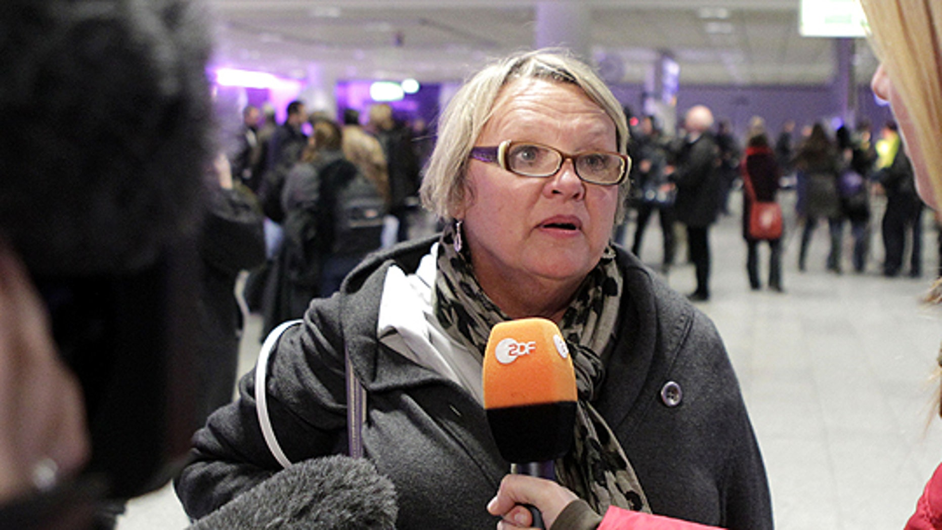 Feb. 22: Didi Blackburn from Dallas, Texas, talks to the media at the airport in Frankfurt, central Germany, after she was flown out of Tripoli, Libya.