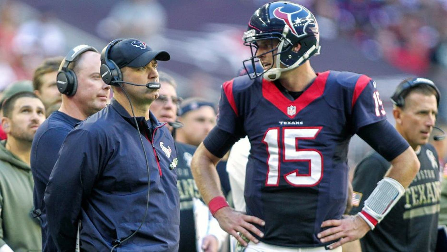 Nov 23, 2014; Houston, TX, USA; Houston Texans head coach Bill O'Brien and quarterback Ryan Mallett (15) on the sideline during the third quarter against the Cincinnati Bengals at NRG Stadium. The Bengals defeated the Texans 22-13. Mandatory Credit: Troy Taormina-USA TODAY Sports