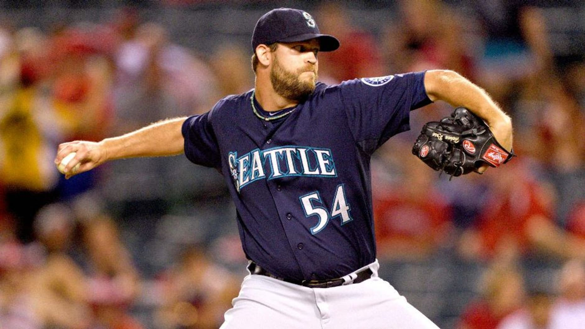 ANAHEIM, CA - SEPTEMBER 16: Tom Wilhelmsen #54 of the Seattle Mariners pitches during the game against the Los Angeles Angels of Anaheim on September 16, 2014 at Angel Stadium of Anaheim in Anaheim, California. (Photo by Matt Brown/Angels Baseball LP/Getty Images)