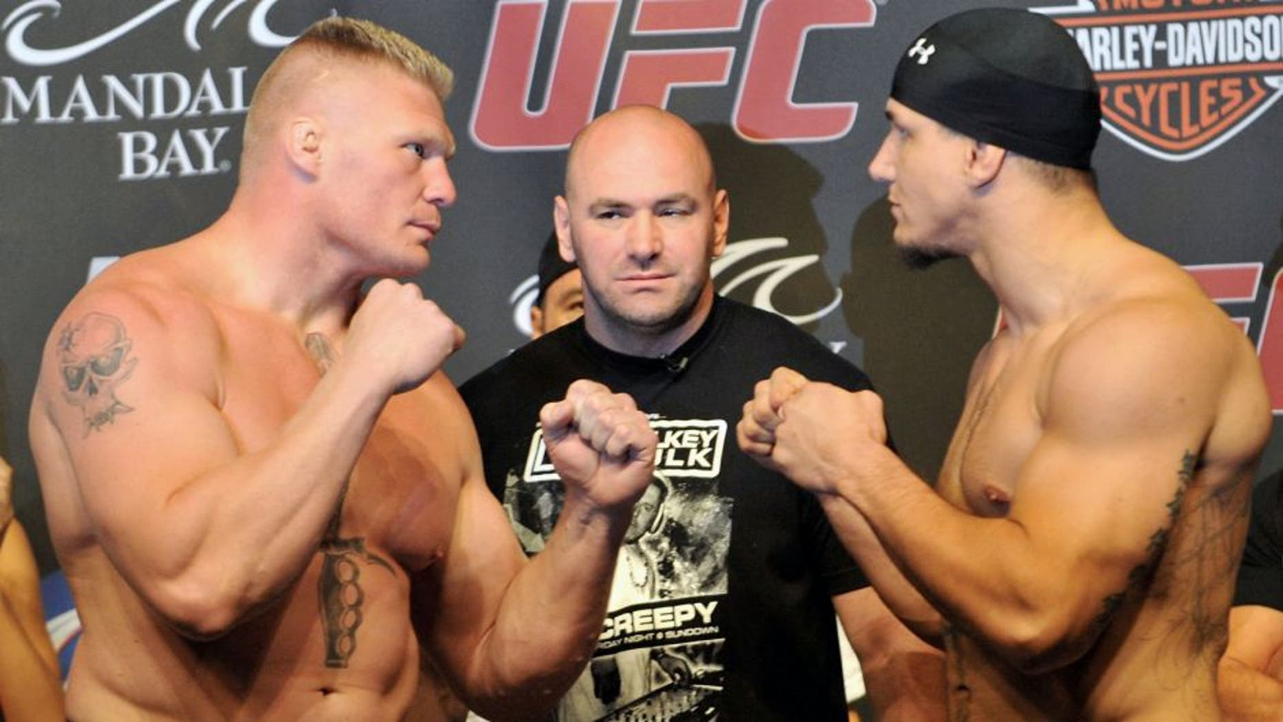 LAS VEGAS - JULY 10: UFC heavyweight fighters Brock Lesnar (L) and Frank Mir (R) square off at UFC 100 Weigh-Ins at the Mandalay Bay Hotel and Casino on July 10, 2009 in Las Vegas, Nevada. (Photo by Jon Kopaloff/Getty Images)