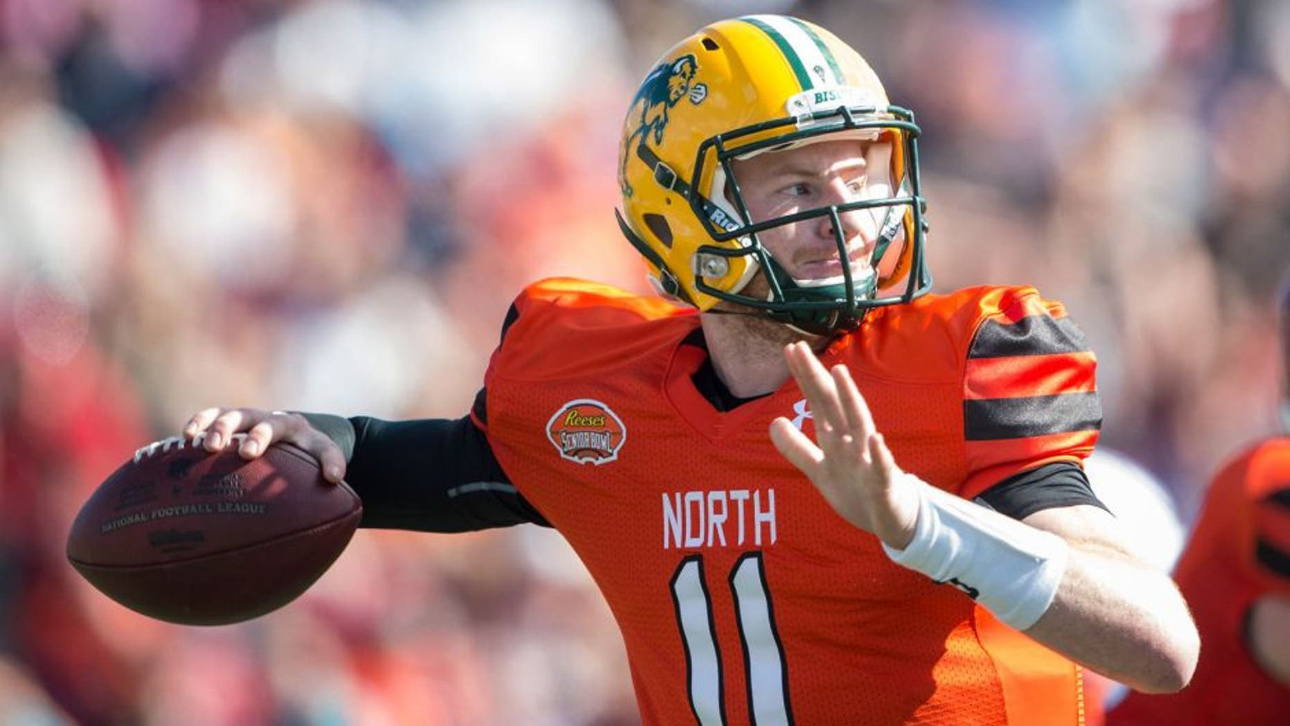 MOBILE, AL - JANUARY 30: North team's quarterback Carson Wentz #11 with North Dakota State looks to throw a pass during their game against the South Team on January 30, 2016 at Ladd-Peebles Stadium in Mobile, Alabama. (Photo by Michael Chang/Getty Images)