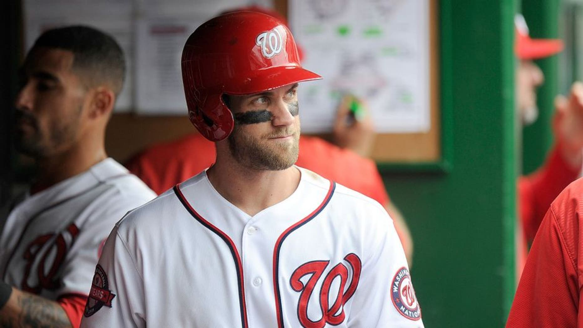 WASHINGTON, DC - SEPTEMBER 27: Bryce Harper #34 of the Washington Nationals watches the game against the Philadelphia Phillies at Nationals Park on September 27, 2015 in Washington, DC. (Photo by G Fiume/Getty Images)