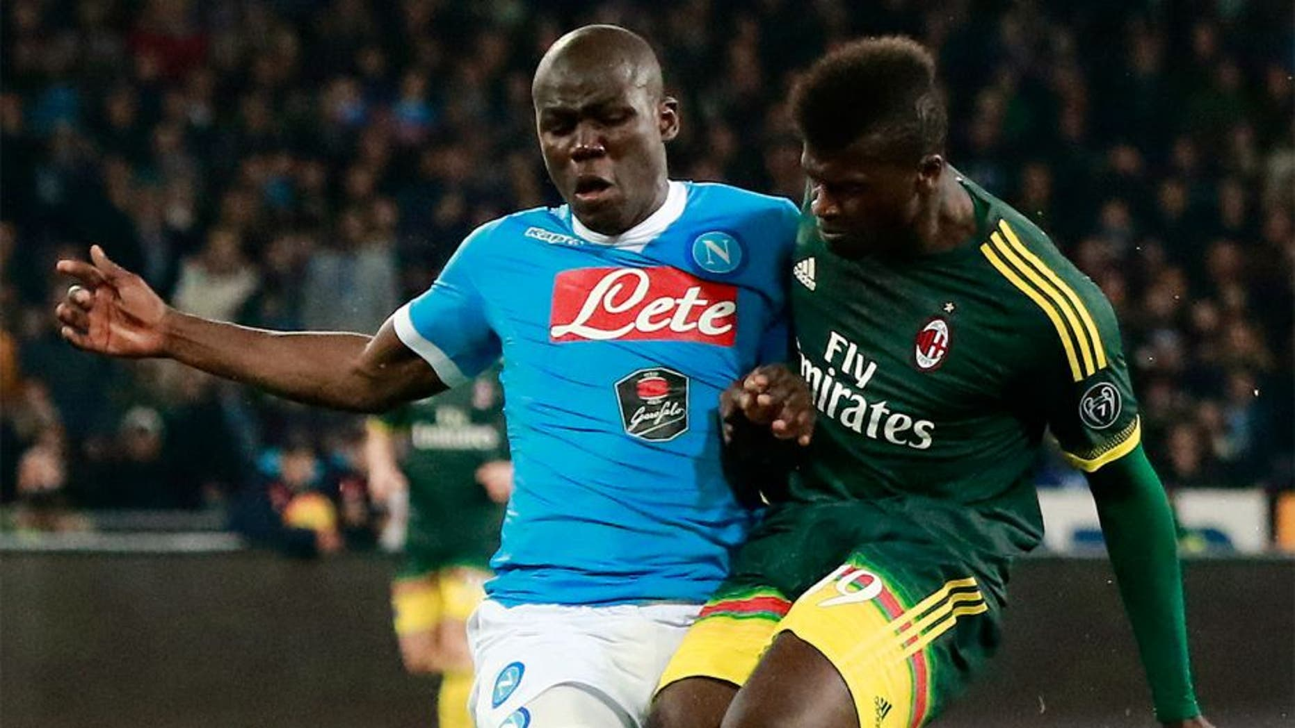AC Milan's French forward M'Baye Niang (R) fights for the ball with Napoli's French defender Kalidou Koulibaly during the Italian Serie A football match SSC Napoli vs AC Milan on February 22, 2016 at the San Paolo stadium in Naples. / AFP / CARLO HERMANN (Photo credit should read CARLO HERMANN/AFP/Getty Images)