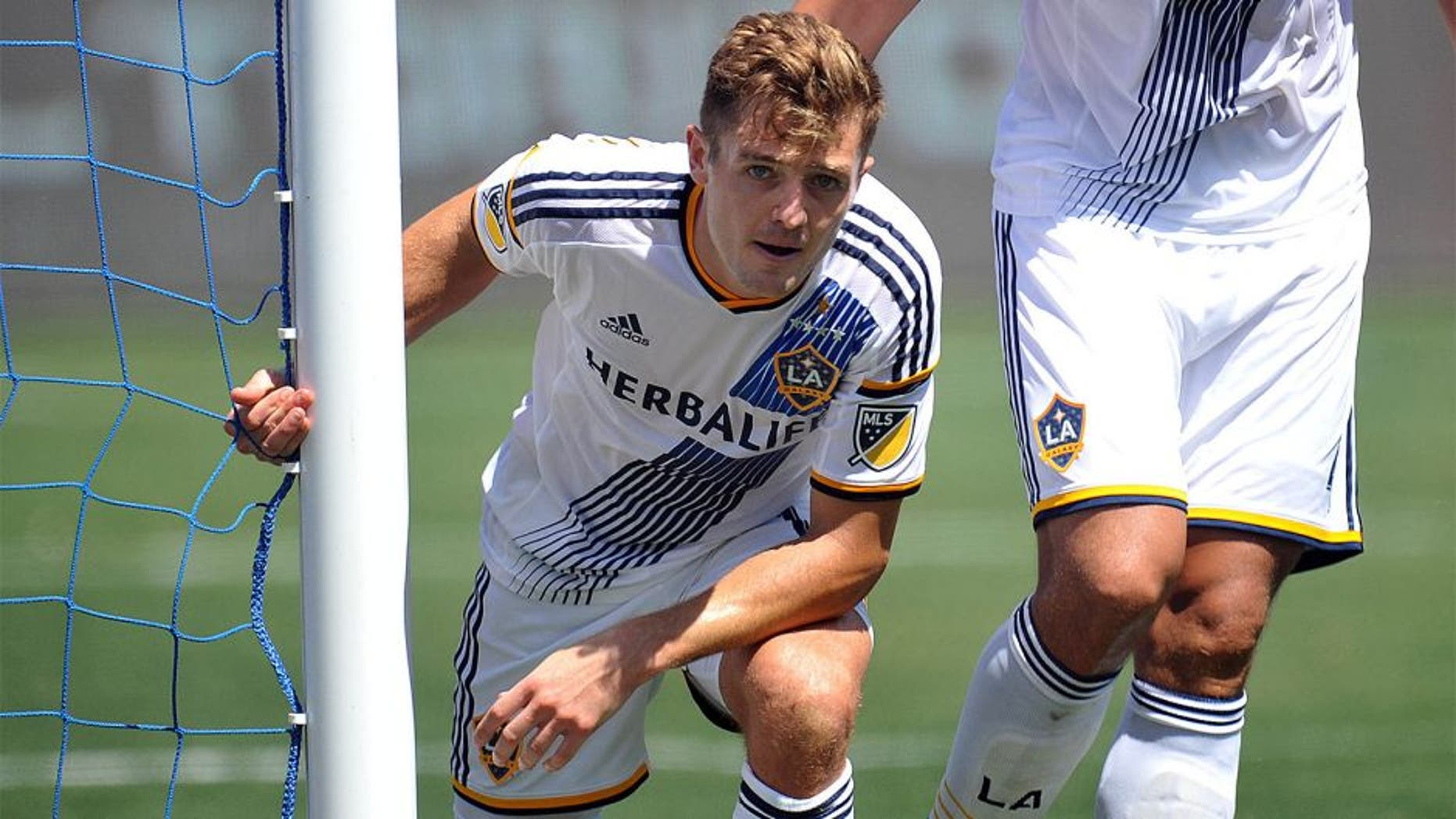 August 9, 2015; Carson, CA, USA; Los Angeles Galaxy midfielder Robbie Rogers (14) reacts after making a defensive play against Seattle Sounders during the second half at StubHub Center. Mandatory Credit: Gary A. Vasquez-USA TODAY Sports