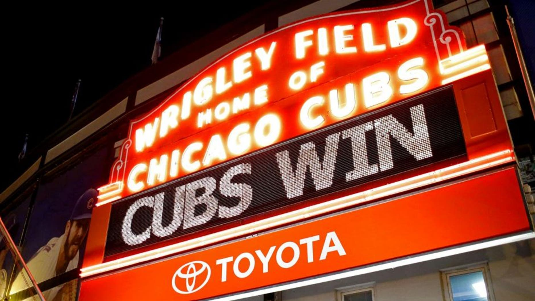 "CHICAGO, IL - OCTOBER 13: The Wrigley Field marquee shows ""Cubs Win"" after the Chicago Cubs beat the St. Louis Cardinals in Game Four to win the National League Divisional Series on October 13, 2015 in Chicago, Illinois. (Photo by Jon Durr/Getty Images)"
