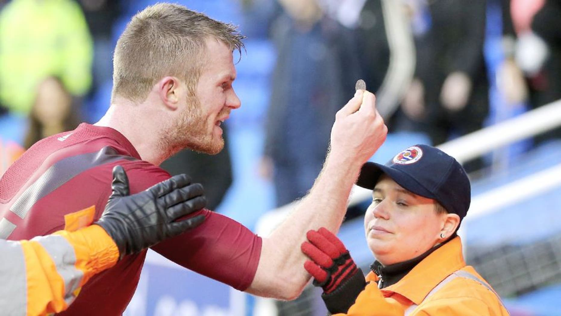 READING, ENGLAND - FEBRUARY 20: Chris Brunt of West Bromwich Albion is held back by stewards as he holds up the coin that was thrown at him by his own supporters after the Emirates FA Cup match between Reading and West Bromwich Albion at Madejski Stadium on February 20, 2016 in Reading, England. (Photo by Adam Fradgley - AMA/ Getty Images)