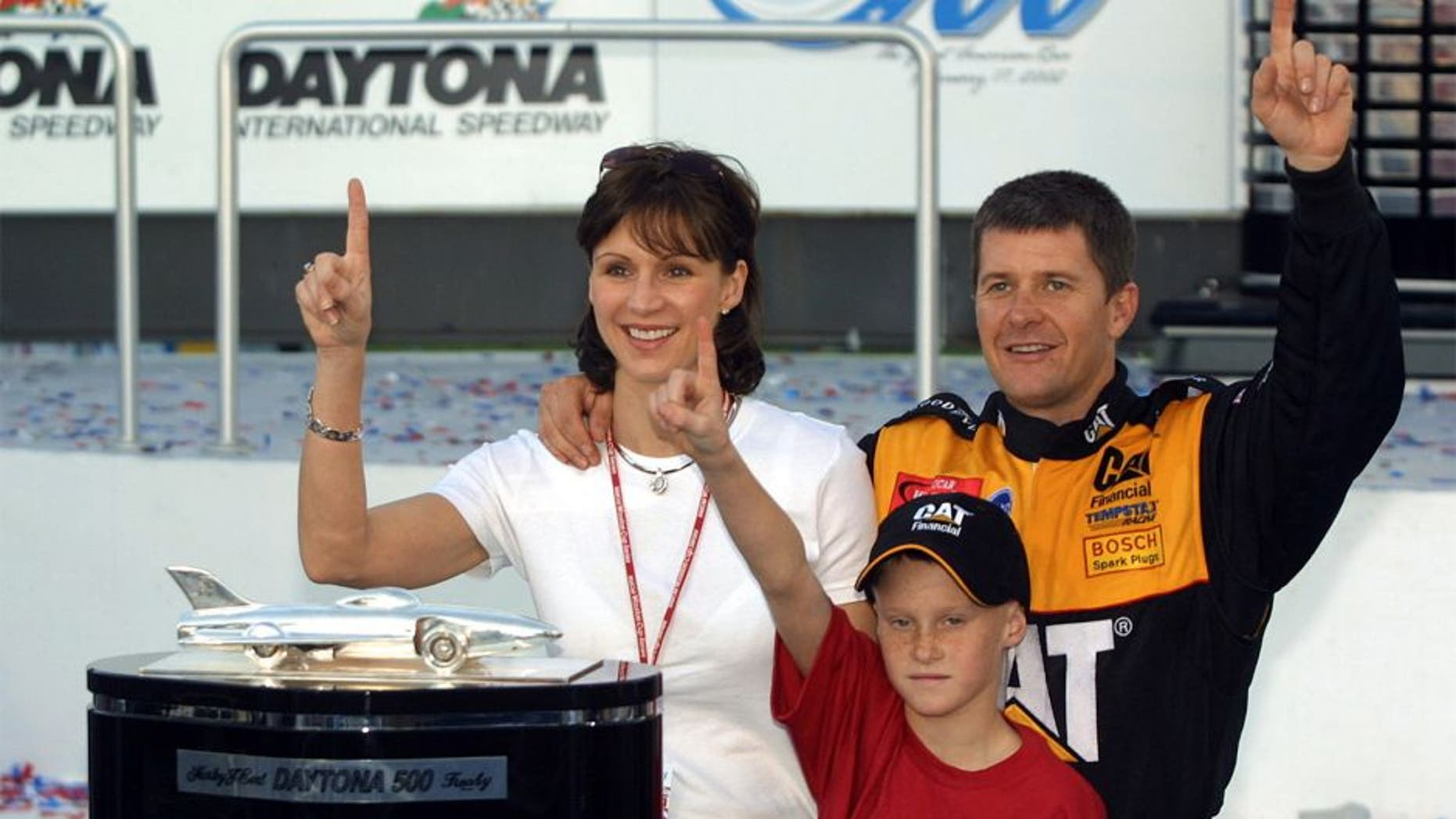 Winner Ward Burton with wife Tabitha and son Jeb in victory lane (Photo by Kevin Kane/WireImage)
