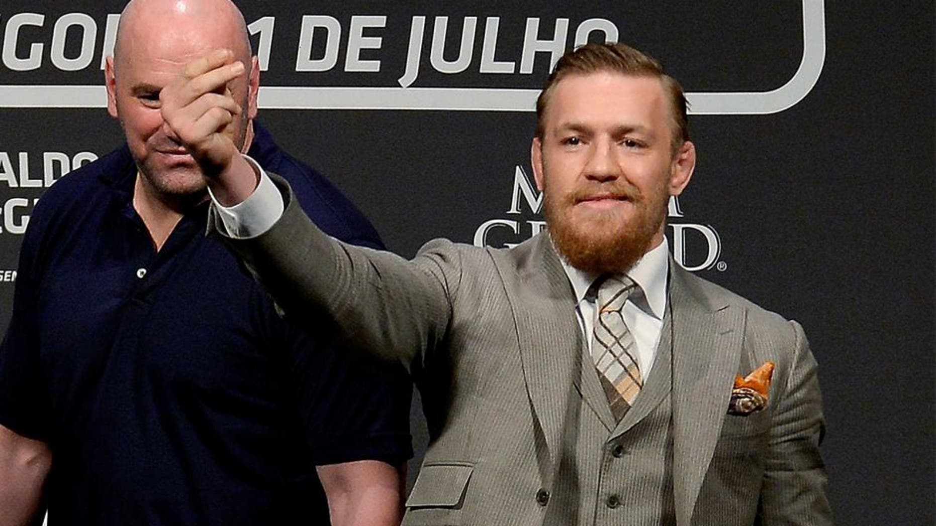 RIO DE JANEIRO, BRAZIL - MARCH 20: UFC featherweight champion Jose Aldo of Brazil (L) and challenger Conor McGregor of Irleland face off as UFC President Dana White (C) stands in during the 189 World Media Tour Launch press conference at Maracanazinho, at Maracanazinho on March 20, 2015 in Rio de Janeiro, Brazil. (Photo by Alexandre Loureiro/Zuffa LLC/Zuffa LLC via Getty Images)