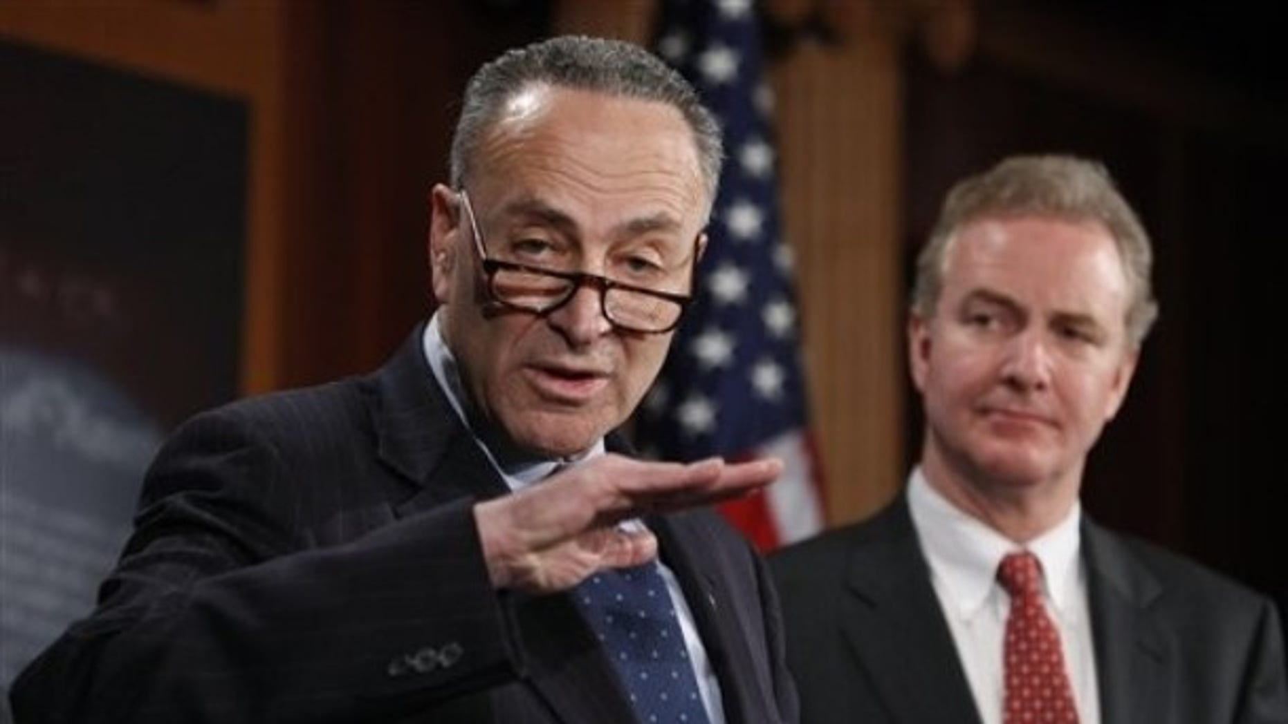 Sen. Charles Schumer, D-N.Y., left,  accompanied by Rep. Chris Van Hollen, D-Md., gestures during a  news conference introducing a bill to undo the Supreme Court's Citizens United ruling, Thursday, Feb. 11, 2010, on Capitol Hill in Washington.  (AP Photo/Manuel Balce Ceneta)