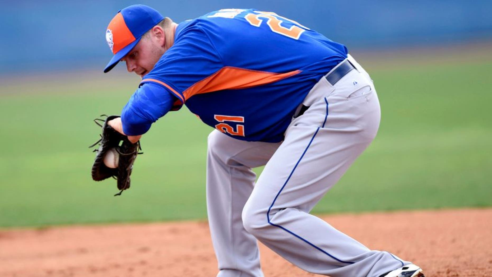 Feb 23, 2015; Port St. Lucie, FL, USA; New York Mets first baseman Lucas Duda (21) fields a ground ball during spring training at Tradition Field. Mandatory Credit: Brad Barr-USA TODAY Sports