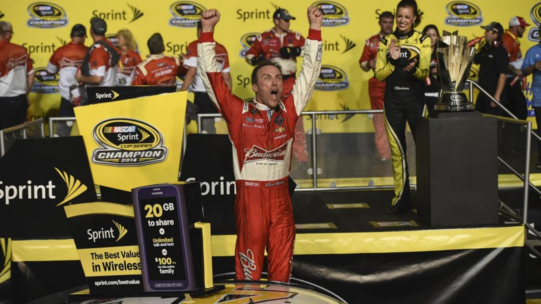 HOMESTEAD, FL - NOVEMBER 16: Kevin Harvick, driver of the #4 Budweiser Chevrolet, celebrates in victory lane after winning during the NASCAR Sprint Cup Series Ford EcoBoost 400 at Homestead-Miami Speedway on November 16, 2014 in Homestead, Florida.