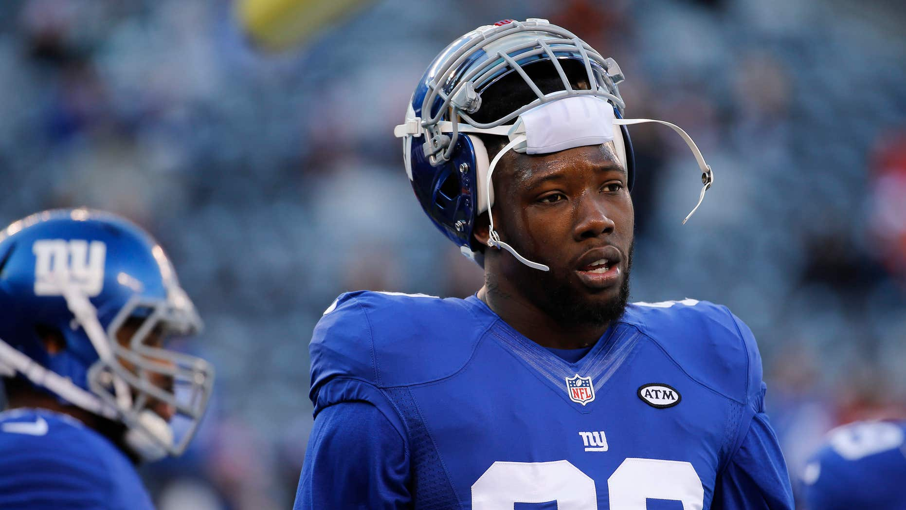 FILE - In this Jan. 3, 2016, file photo, New York Giants defensive end Jason Pierre-Paul (90) warms up before playing against the Philadelphia Eagles in an NFL football game in East Rutherford, N.J.