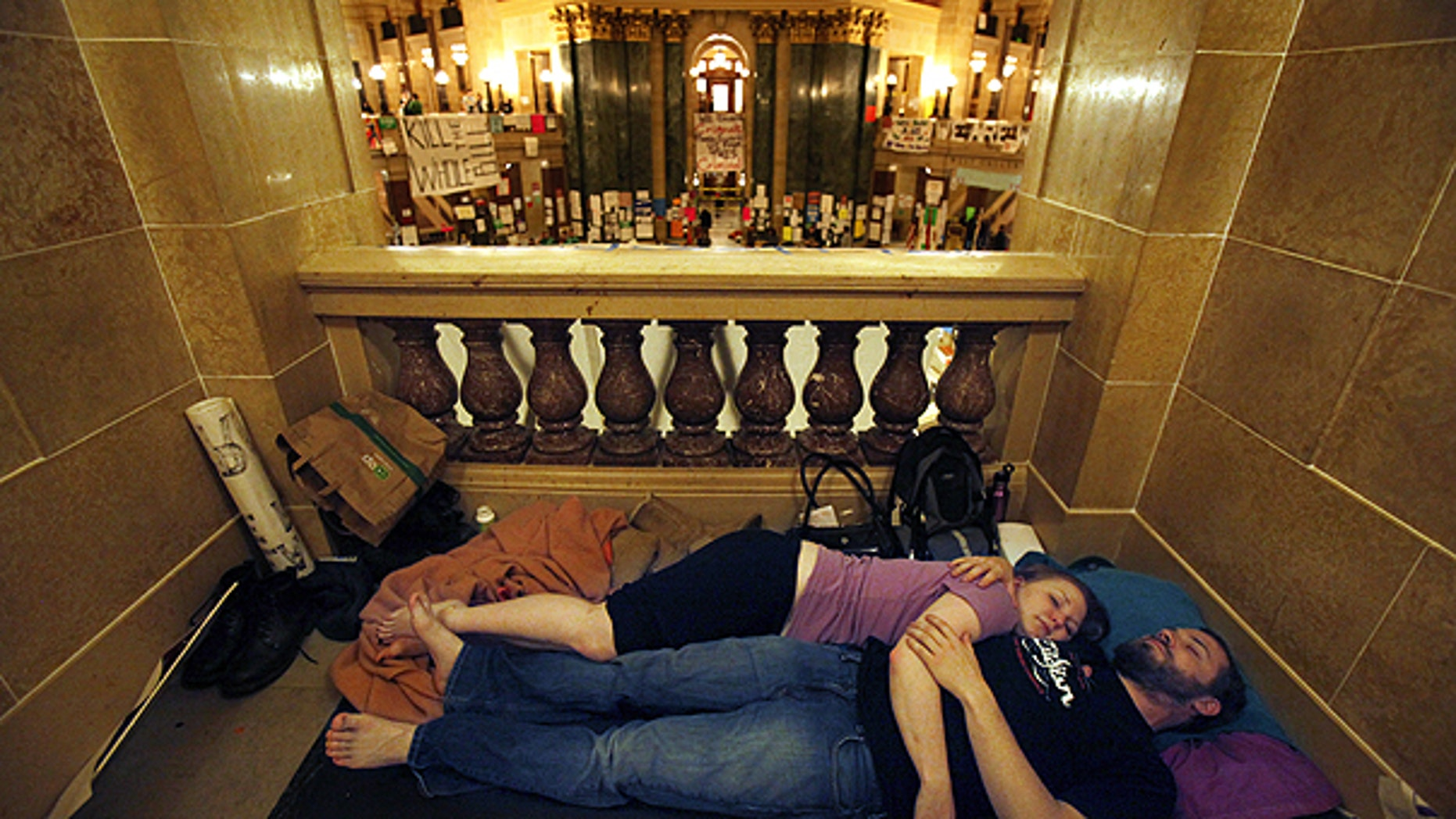 Feb. 23: Opponents to Gov. Scott Walker's bill to eliminate collective bargaining rights for many state workers sleep in the Capitol in Madison, Wis., after a day of protesting.