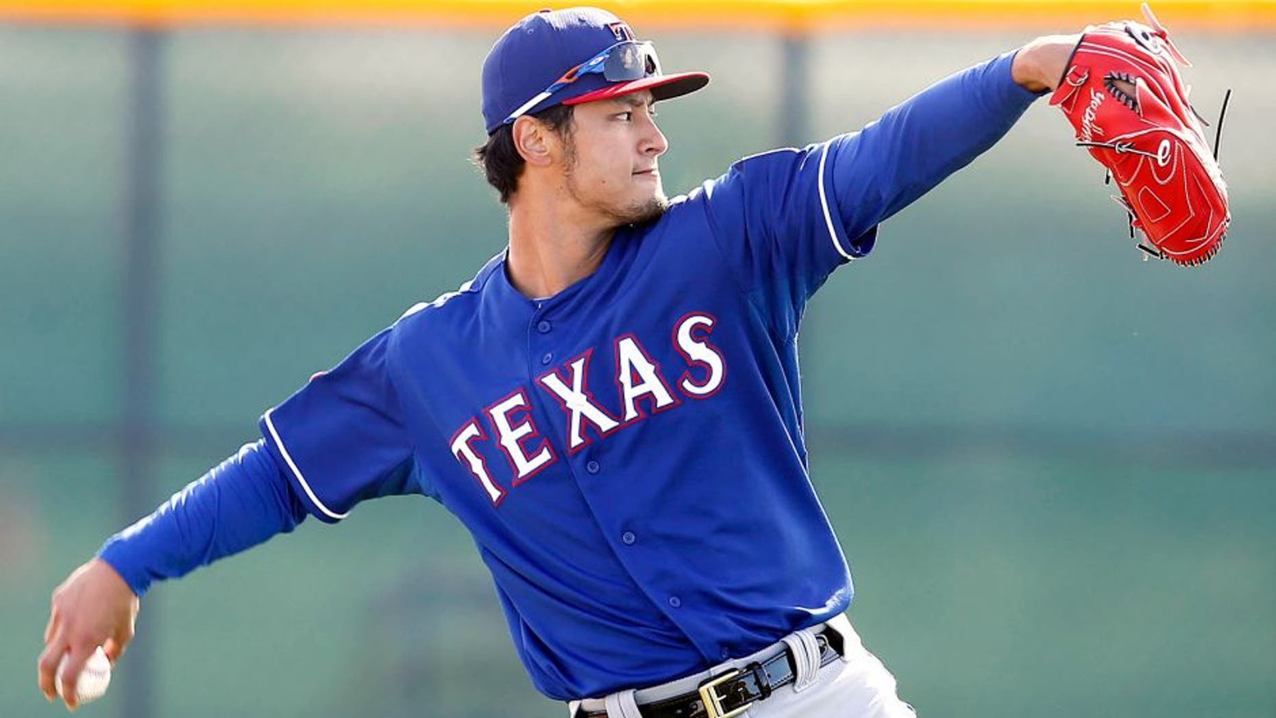 Feb 24, 2015; Surprise, AZ, USA; Texas Rangers starting pitcher Yu Darvish (11) warms up during spring training camp at Surprise Stadium. Mandatory Credit: Rick Scuteri-USA TODAY Sports