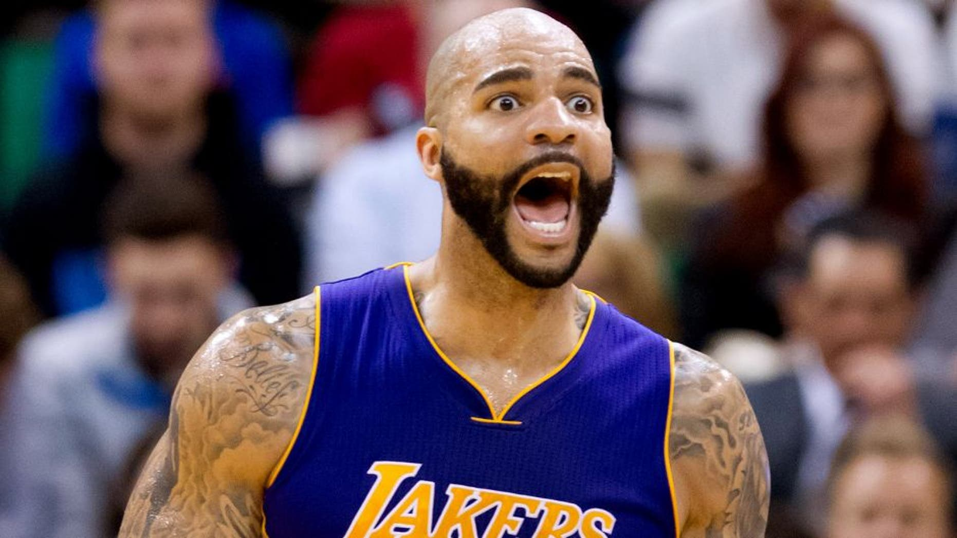 Feb 25, 2015; Salt Lake City, UT, USA; Los Angeles Lakers forward Carlos Boozer (5) reacts during the second half against the Utah Jazz at EnergySolutions Arena. The Lakers won 100-97. Mandatory Credit: Russ Isabella-USA TODAY Sports