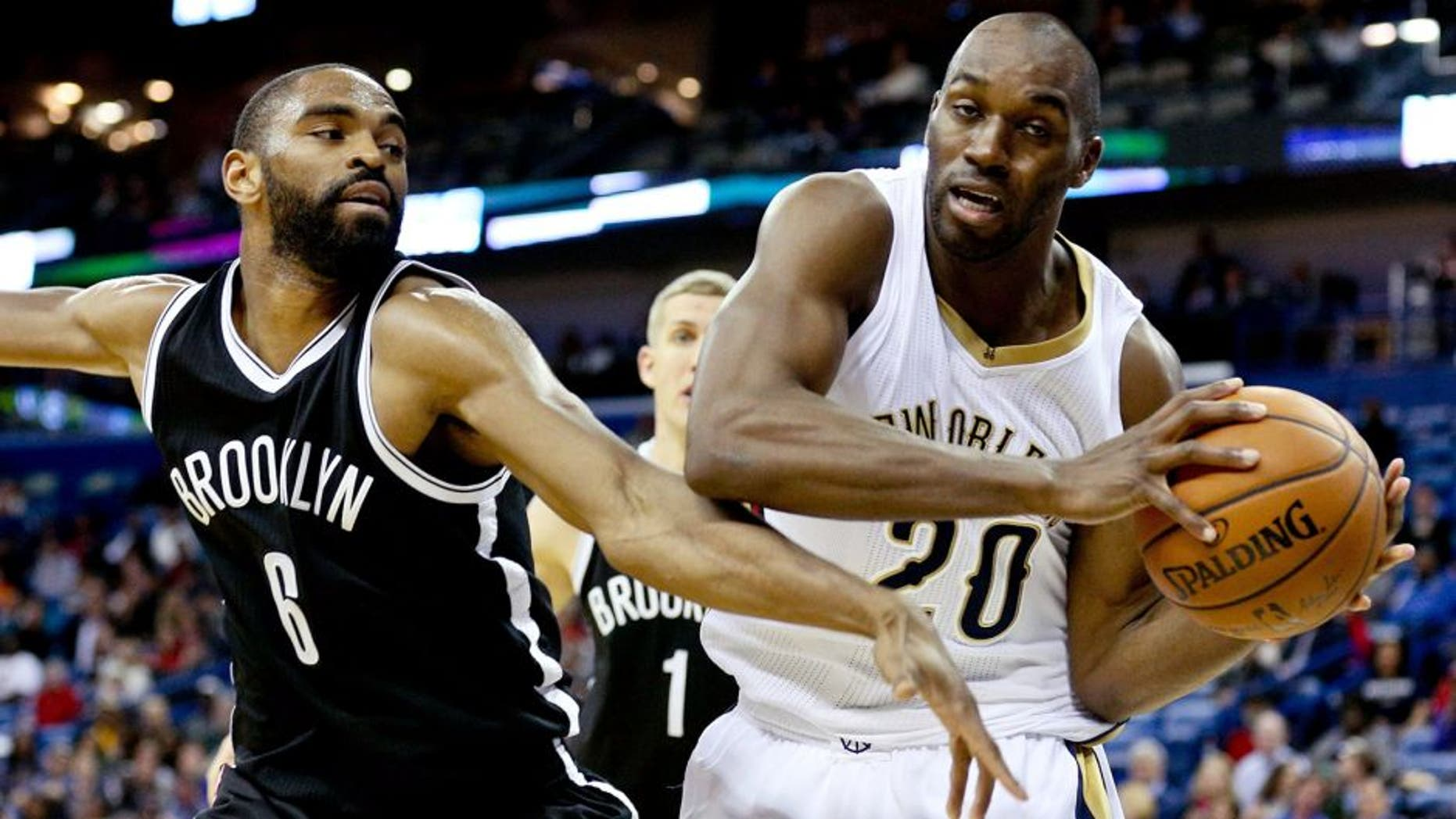 Feb 25, 2015; New Orleans, LA, USA; New Orleans Pelicans guard Quincy Pondexter (20) is defended by Brooklyn Nets guard Alan Anderson (6) during the fourth quarter of a game at the Smoothie King Center. The Pelicans defeated the Nets 102-96. Mandatory Credit: Derick E. Hingle-USA TODAY Sports