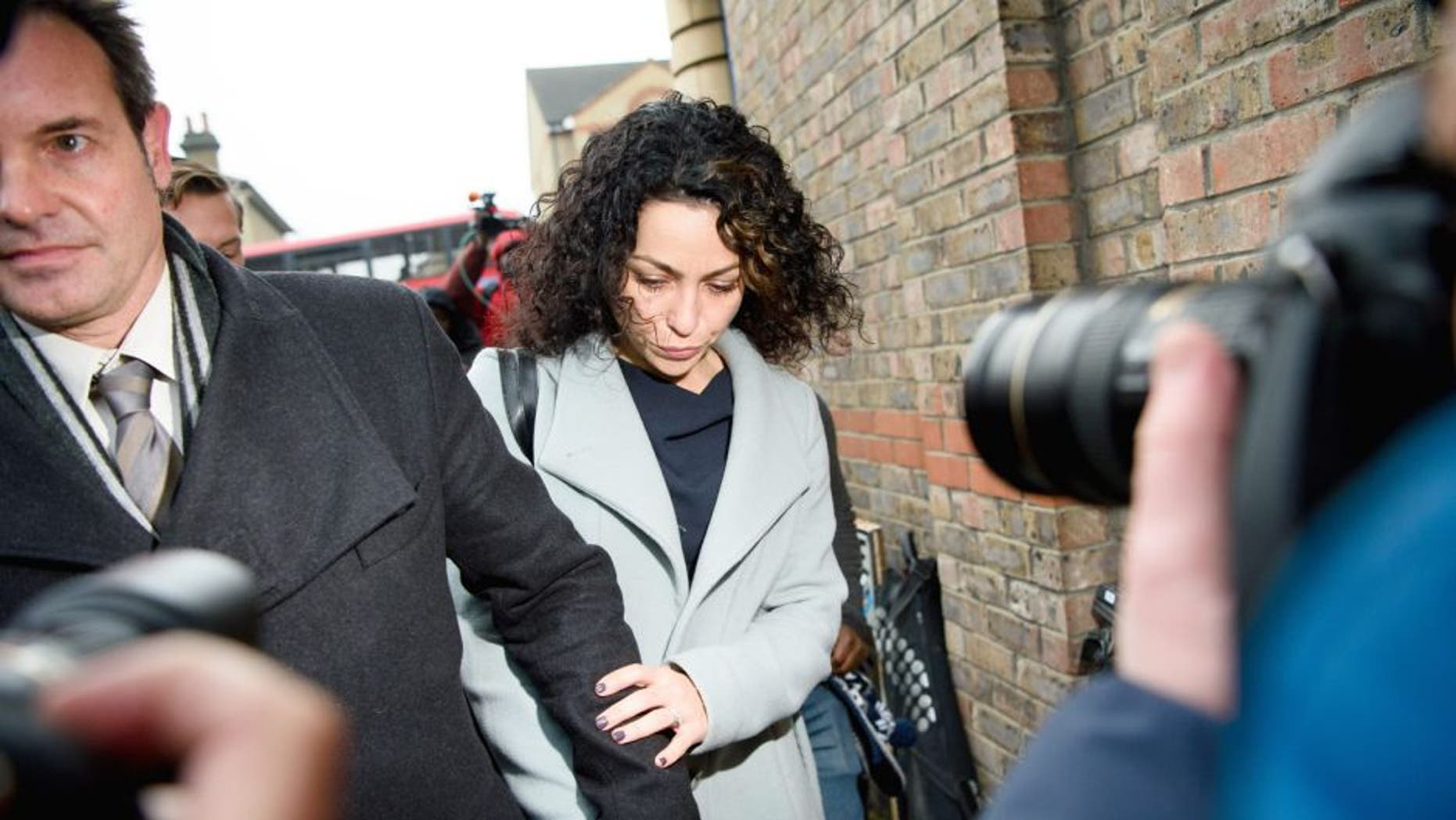 Former Chelsea first-team doctor Eva Carneiro (C) accompanied by her husband Jason De Carteret (L) leaves Croydon employment tribunal in London on January 6, 2016. Carneiro attended the tribunal hearing today regarding her constructive dismissal case against the club. The preliminary hearing at London South Employment Tribunal is being held in private before an employment judge and will outline the timetable for the case. AFP PHOTO / LEON NEAL / AFP / LEON NEAL (Photo credit should read LEON NEAL/AFP/Getty Images)