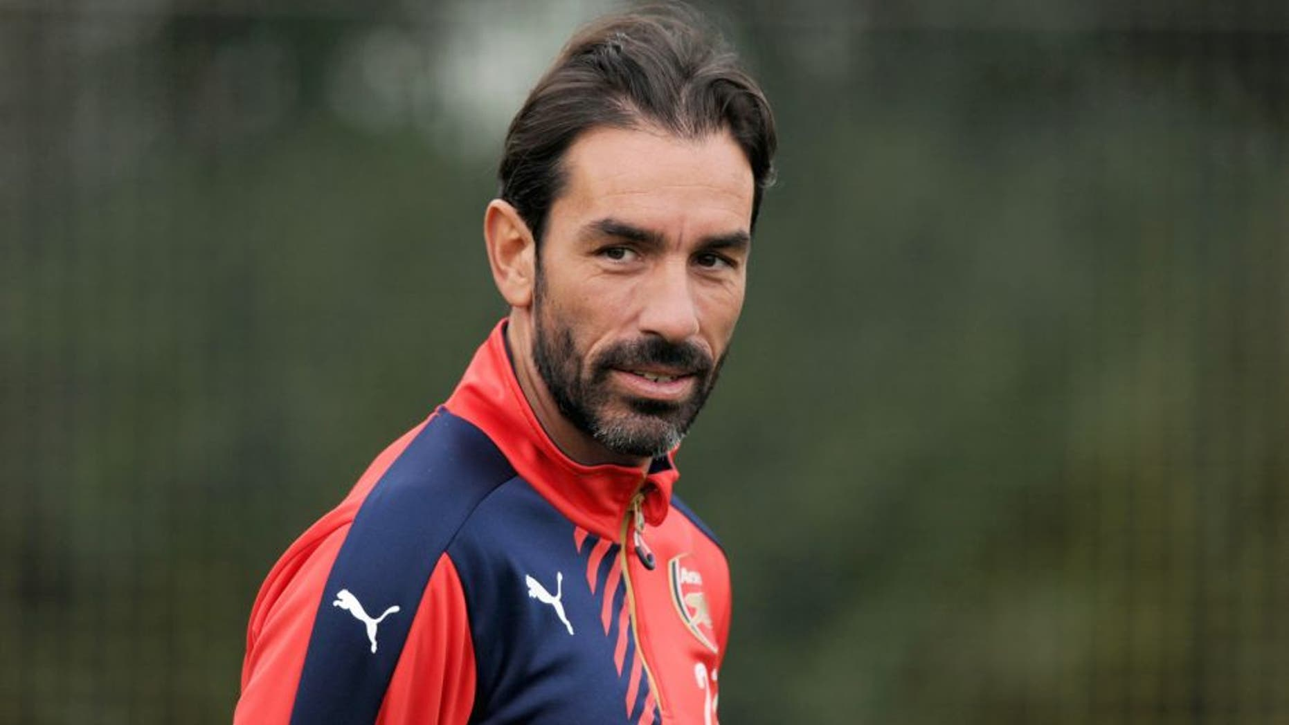ST ALBANS, ENGLAND - OCTOBER 23: ex Arsenal player Robert Pires watches a training session at London Colney on October 23, 2015 in St Albans, England. (Photo by Stuart MacFarlane/Arsenal FC via Getty Images)