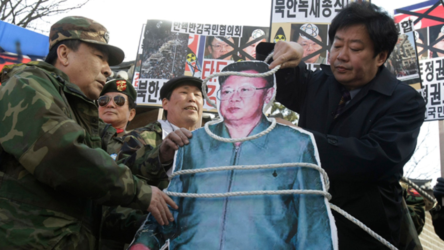 Feb. 25: A South Korean conservative coils a rope around an image of North Korean leader Kim Jong Il  during a rally against Kim's rule and to show support for the uprising in the Middle East countries, in Seoul, South Korea.