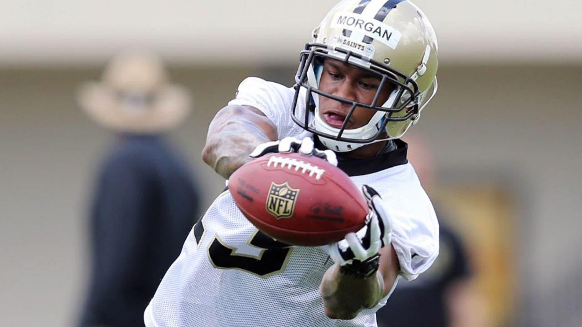 Jun 4, 2013; New Orleans, LA, USA; New Orleans Saints wide receiver Joseph Morgan (13) makes a catch during the team's first minicamp practice at the Saints practice facility. Mandatory Credit: Chuck Cook-USA TODAY Sports