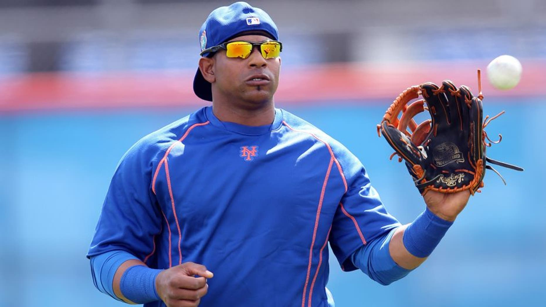 Feb 22, 2016; Port St. Lucie, FL, USA; New York Mets left fielder Yoenis Cespedes (52) warms up during spring training work out drills at Tradition Field. Mandatory Credit: Steve Mitchell-USA TODAY Sports