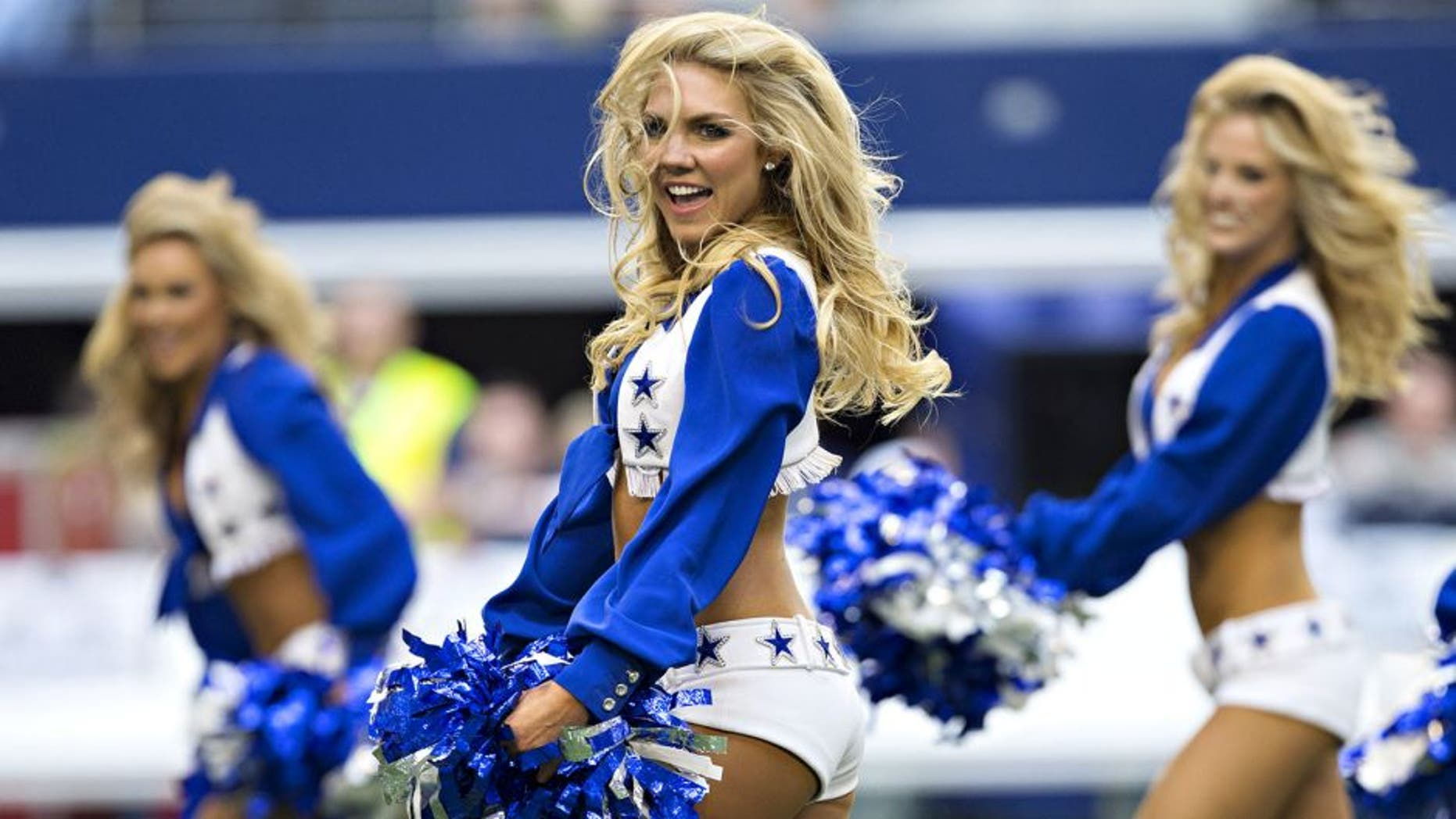 ARLINGTON, TX - NOVEMBER 02: Cheerleaders of the Dallas Cowboys perform before a game against the Arizona Cardinals at AT&T Stadium on November 2, 2014 in Arlington, Texas. The Cardinals defeated the Cowboys 28-17. (Photo by Wesley Hitt/Getty Images)