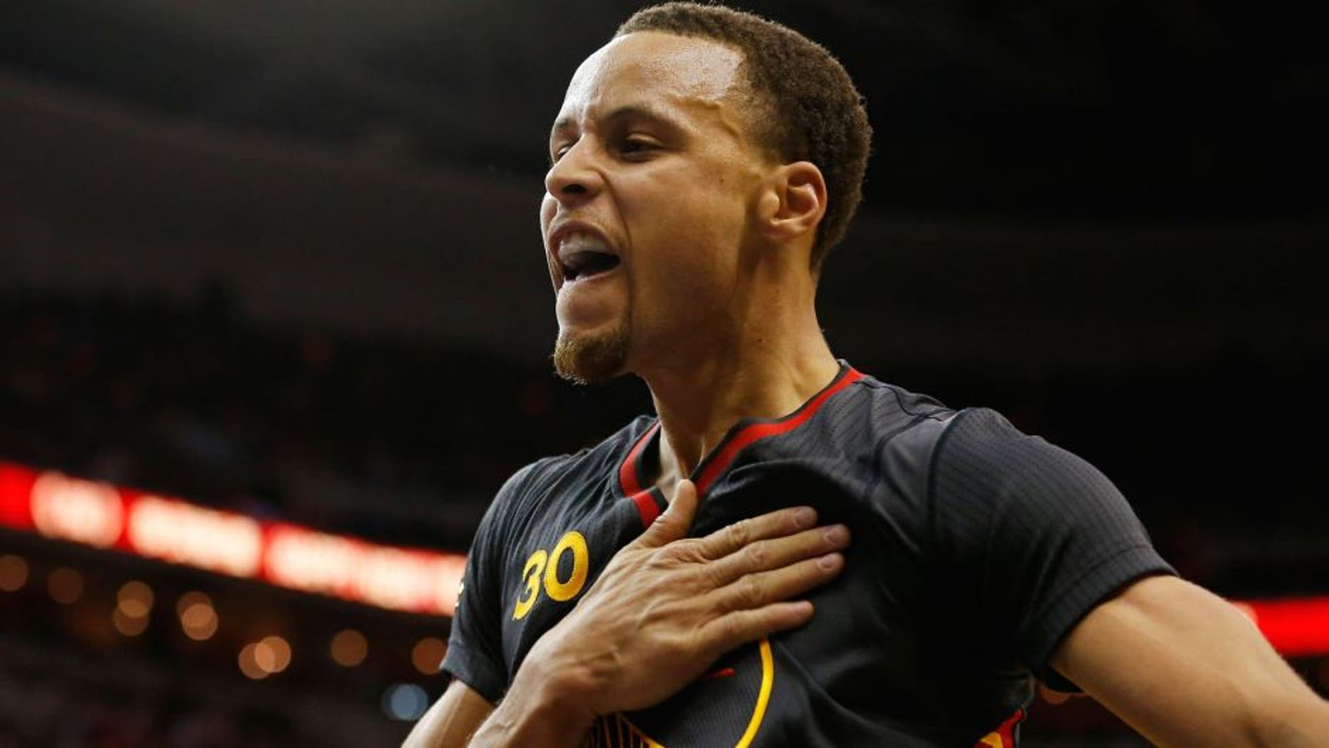 Feb 24, 2015; Washington, DC, USA; Golden State Warriors guard Stephen Curry (30) gestures on the court against the Washington Wizards in the third quarter at Verizon Center. The Warriors won 114-107. Mandatory Credit: Geoff Burke-USA TODAY Sports