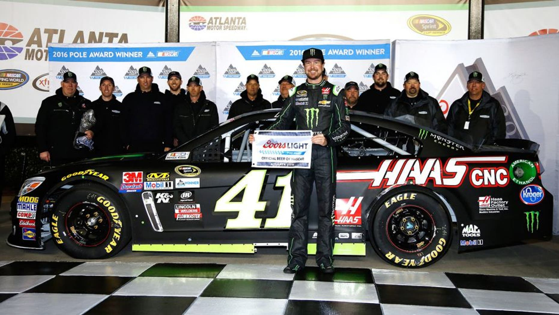 HAMPTON, GA - FEBRUARY 26: Kurt Busch, driver of the #41 Monster Energy/Haas Automation Chevrolet, poses with the Coors Light Pole Award after qualifying for pole position for the NASCAR Sprint Cup Series Folds of Honor QuikTrip 500 at Atlanta Motor Speedway on February 26, 2016 in Hampton, Georgia. (Photo by Todd Warshaw/NASCAR via Getty Images)