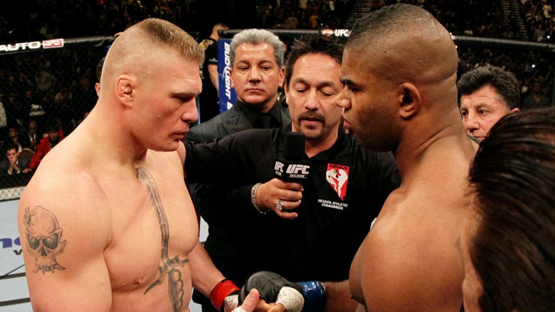 LAS VEGAS, NV - DECEMBER 30: (L-R) Heavyweight opponents Brock Lesnar and Alistair Overeem receive final instructions from the referee before their main event bout during the UFC 141 event at the MGM Grand Garden Arena on December 30, 2011 in Las Vegas, Nevada. (Photo by Josh Hedges/Zuffa LLC/Zuffa LLC via Getty Images)