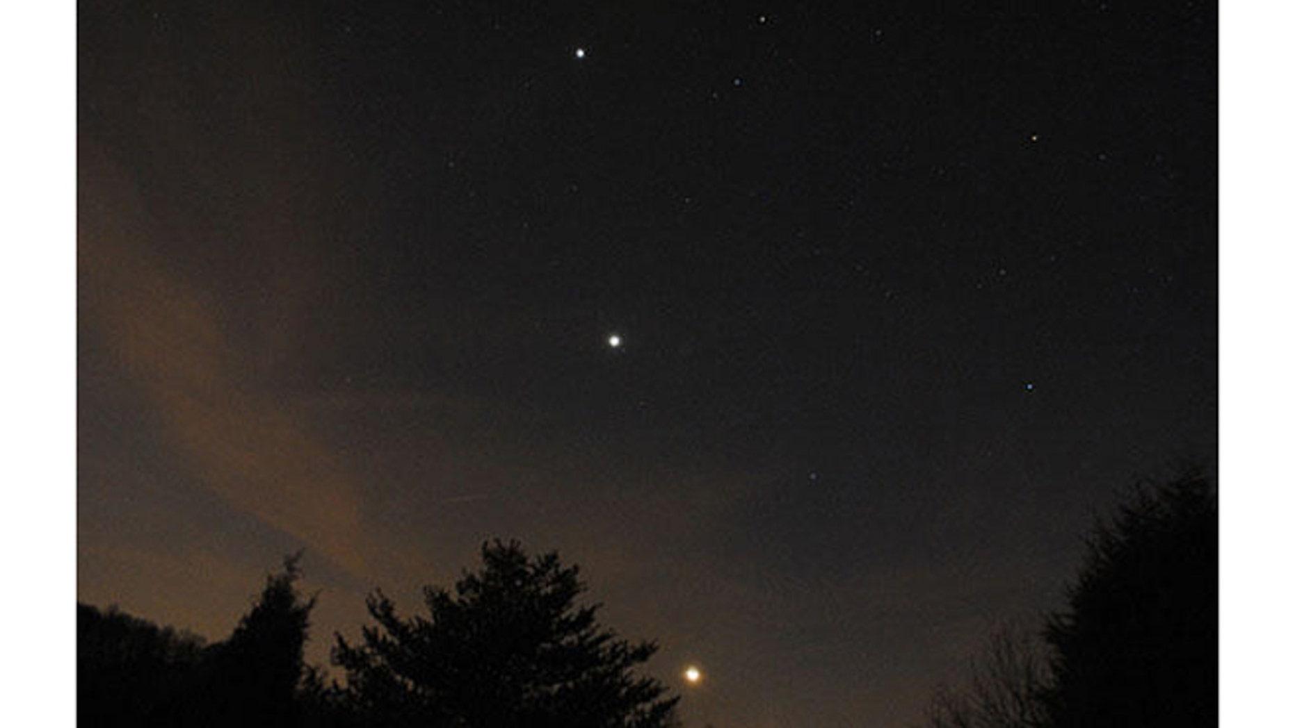 Astrophotographer John Green caught the moon, Venus and Jupiter over Mooresville, N.C., last week.