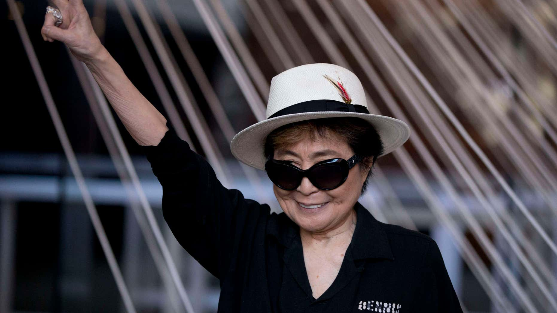 """Feb. 2, 2016: Yoko Ono poses for photographers in front of a work entitled """"Morning Beams/River Bed,"""" at a press event to mark the opening of her exhibiition """"Land of Hope"""" at the Museum of Memory and Tolerance in Mexico City."""