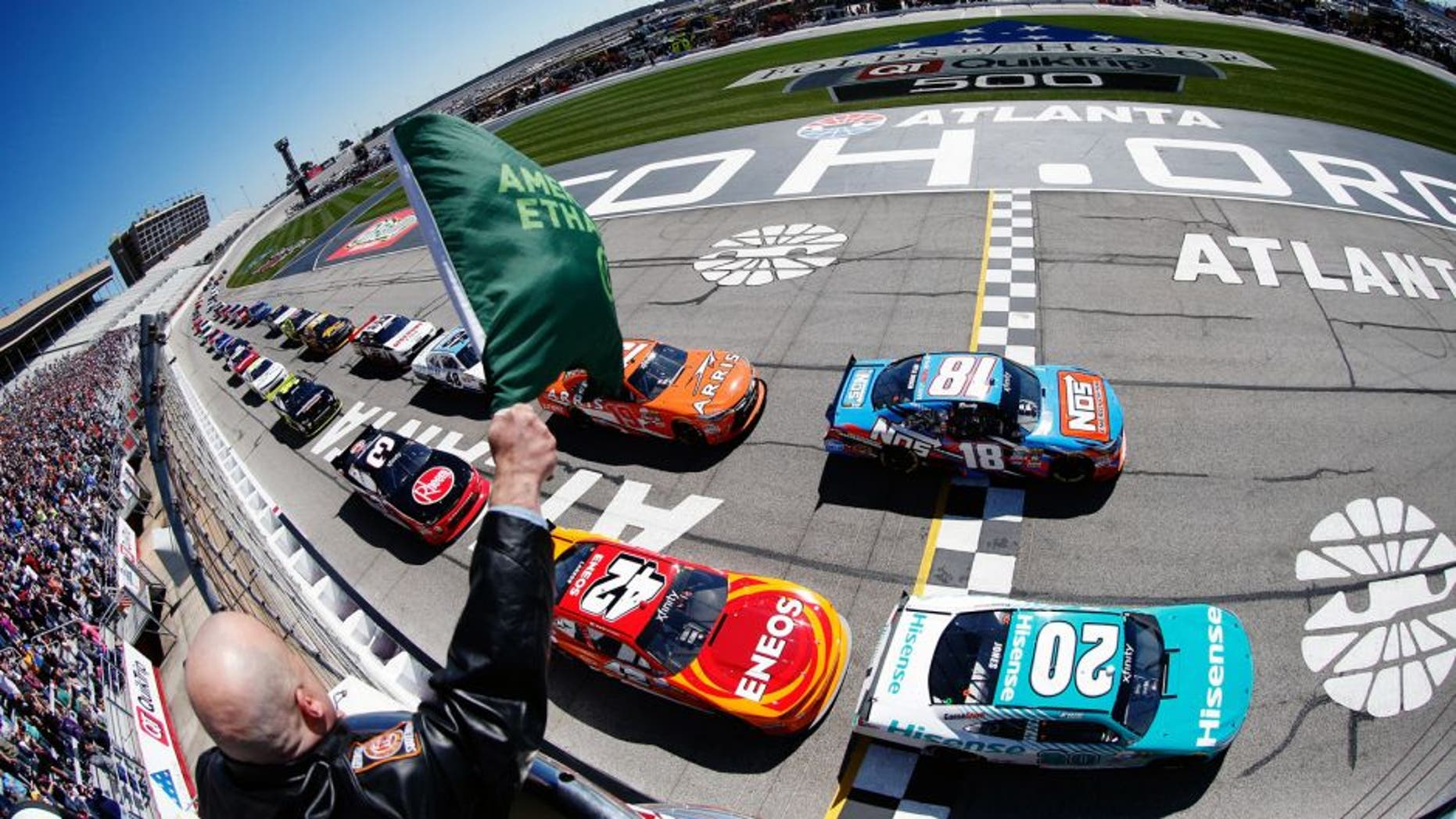 HAMPTON, GA - FEBRUARY 27: Kyle Busch, driver of the #18 NOS Energy Drink Toyota, and Erik Jones, driver of the #20 Hisense USA Toyota, lead the field past the green flag to start the NASCAR XFINITY Series Heads Up Georgia 250 at Atlanta Motor Speedway on February 27, 2016 in Hampton, Georgia. (Photo by Matt Sullivan/NASCAR via Getty Images)