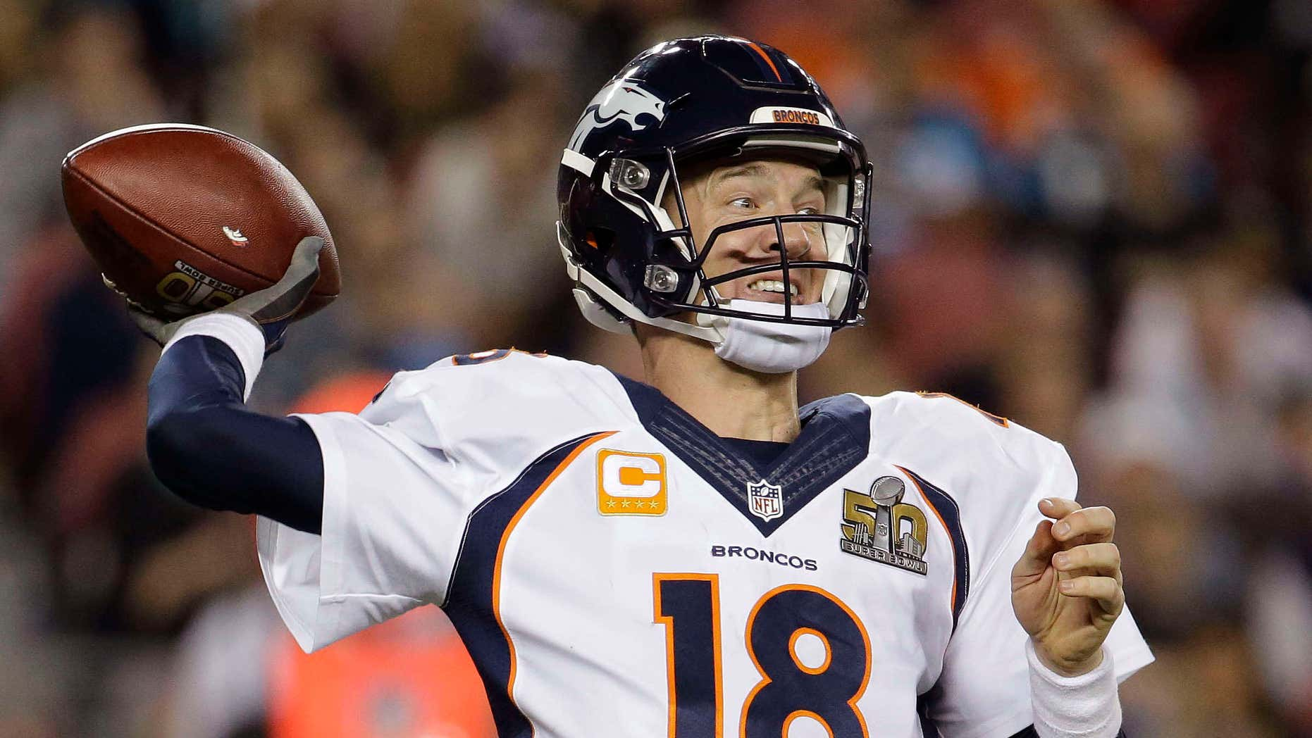 FILE - In this Sunday, Feb. 7, 2016 file photo, Denver Broncos' Peyton Manning (18) passes against the Carolina Panthers during the second half of the NFL Super Bowl 50 football game in Santa Clara, Calif.