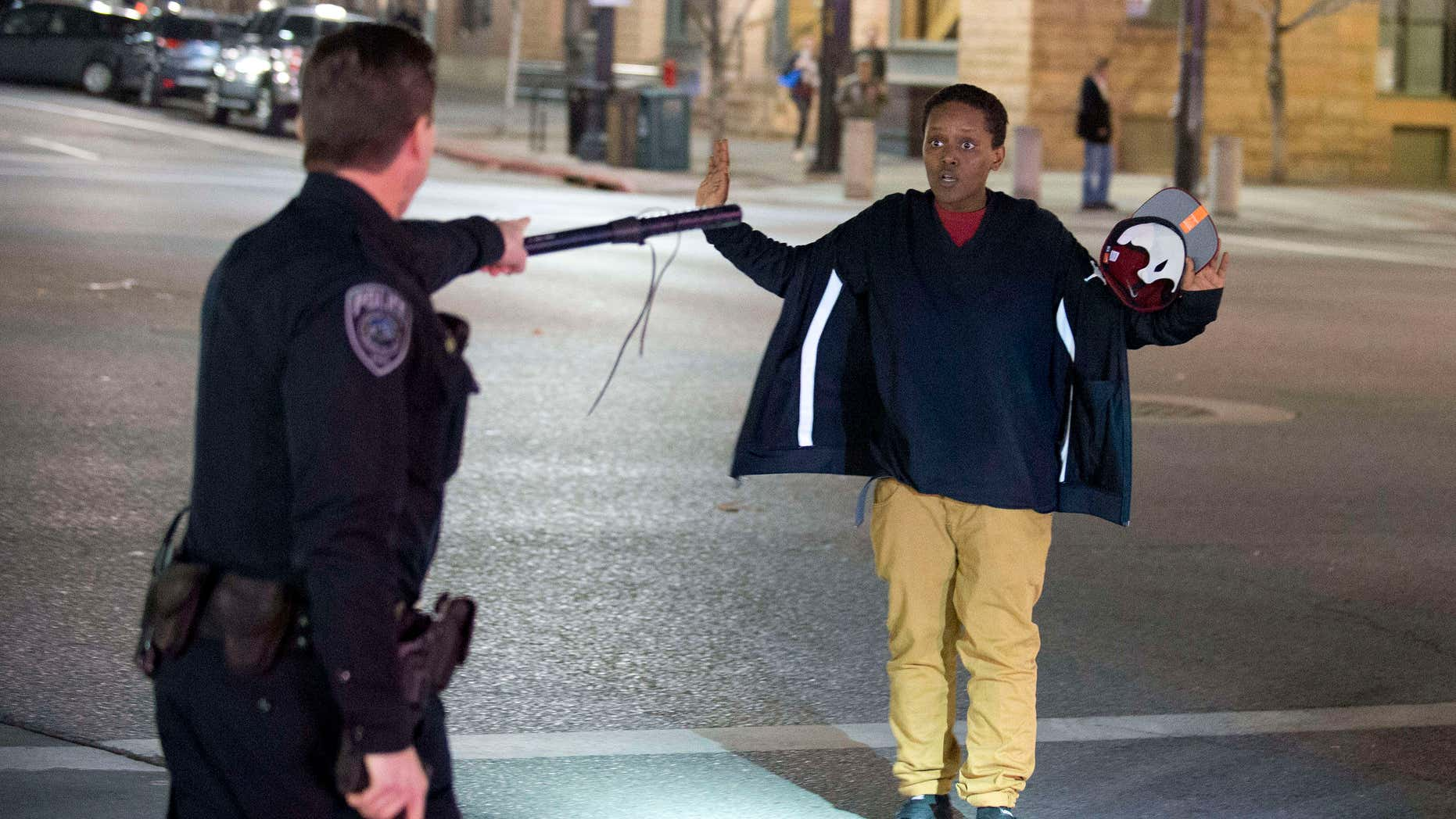 Feb. 27, 2016: Police stop a boy as he walks away from a crowd that formed after an officer-involved shooting at 200 South Rio Grande Street in Salt Lake City.