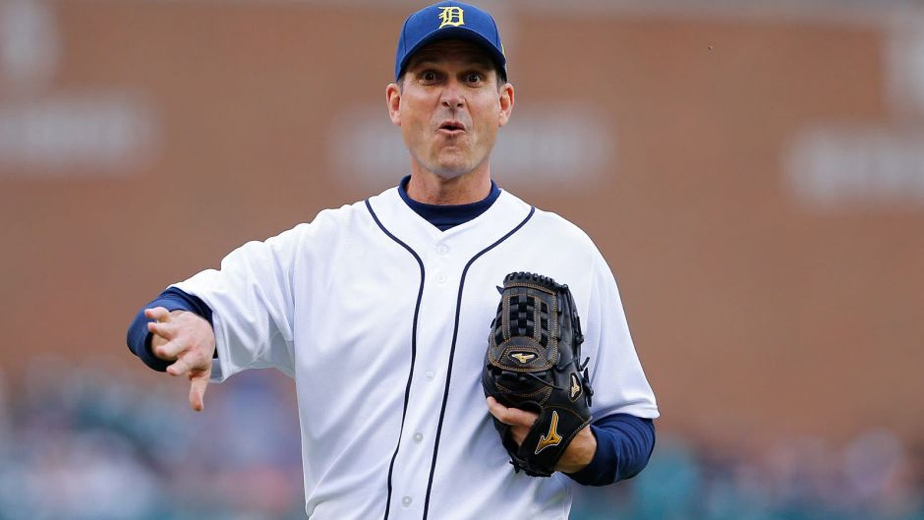 DETROIT, MI - JUNE 30: University of Michigan head football coach Jim Harbaugh throws out the first pitch prior to the start of the interleague game between the Pittsburgh Pirates and the Detroit Tigers play on June 30, 2015 at Comerica Park in Detroit, Michigan. The Pirates defeated the Tigers 5-4 in fourteen innings. (Photo by Leon Halip/Getty Images)