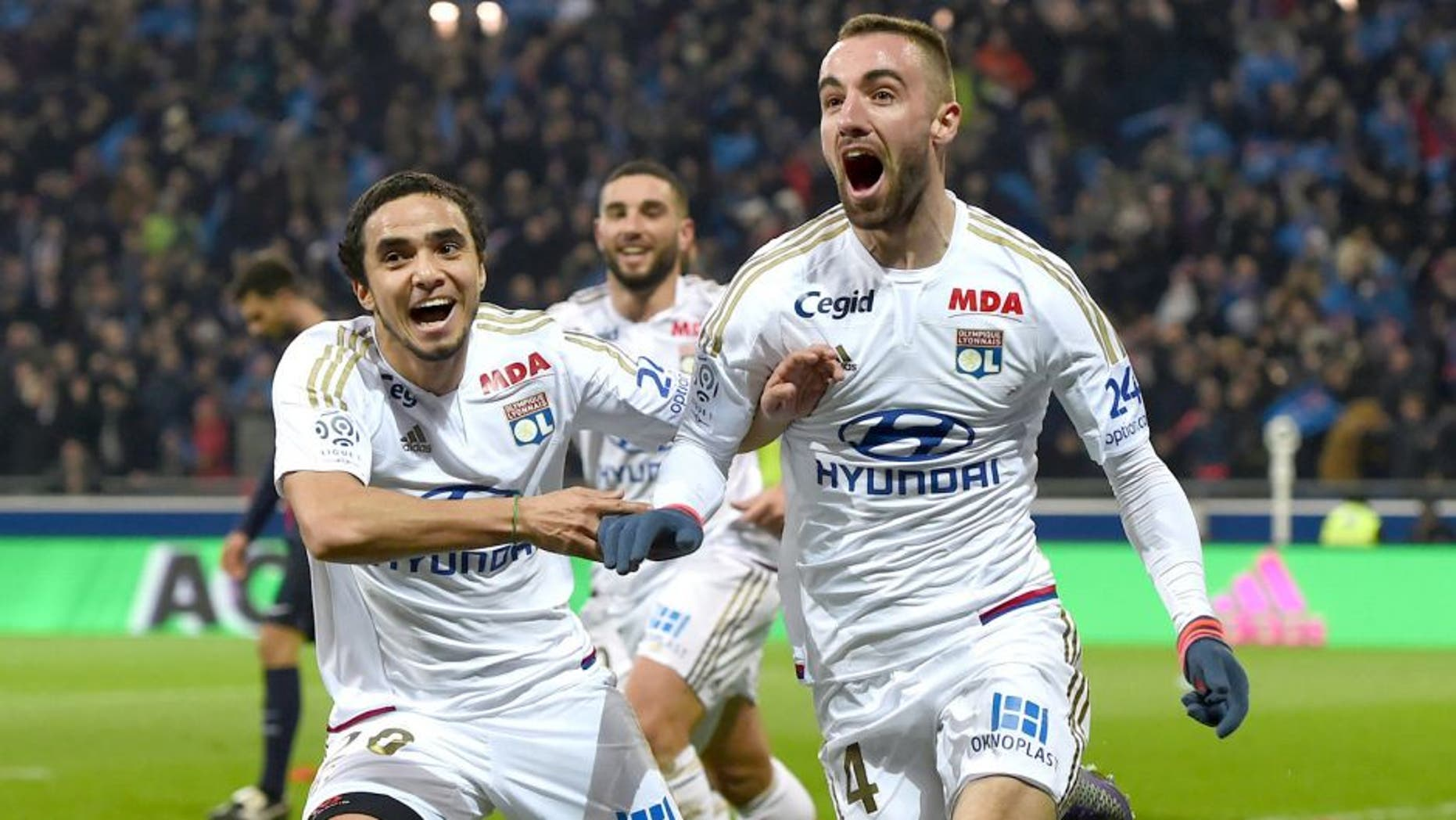 Lyon's Spanish midfielder Sergi Darder (R) reacts after scoring next to Lyon's Brazilian defender Rafael Pereira Da Silva (L) during the French Ligue1 football match between Olympique Lyonnais and Paris Saint-Germain, on February 28, 2016 at the New stadium in Decines-Charpieu near Lyon, southeastern France. AFP PHOTO/PHILIPPE DESMAZES / AFP / PHILIPPE DESMAZES (Photo credit should read PHILIPPE DESMAZES/AFP/Getty Images)