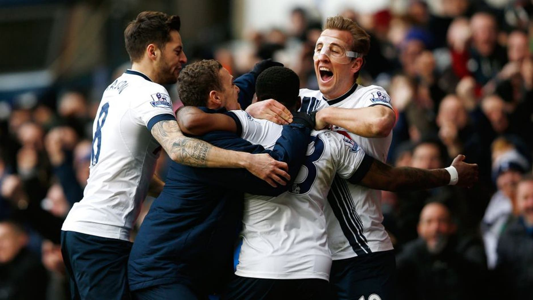 LONDON, ENGLAND - FEBRUARY 28: Danny Rose of Tottenham Hotspur is mobbed by team mates including Harry Kane of Tottenham Hotspur after scoring his team's second goal during the Barclays Premier League match between Tottenham Hotspur and Swansea City at White Hart Lane on February 28, 2016 in London, England. (Photo by Dean Mouhtaropoulos/Getty Images)
