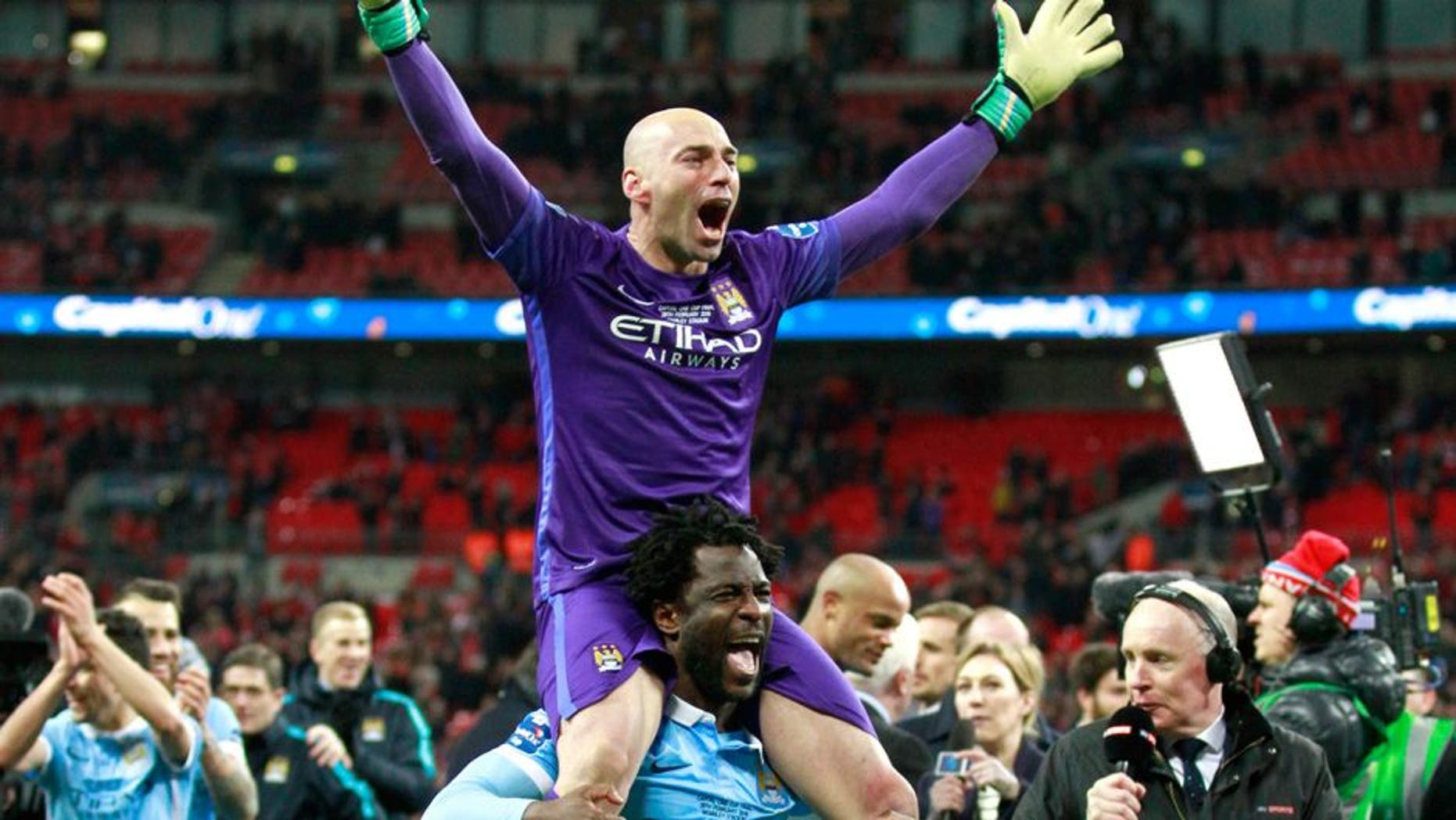 """Football Soccer - Liverpool v Manchester City - Capital One Cup Final - Wembley Stadium - 28/2/16 Manchester City's Wilfredo Caballero and Wilfried Bony celebrate after the game Action Images via Reuters / Paul Childs Livepic EDITORIAL USE ONLY. No use with unauthorized audio, video, data, fixture lists, club/league logos or """"live"""" services. Online in-match use limited to 45 images, no video emulation. No use in betting, games or single club/league/player publications. Please contact your account representative for further details."""