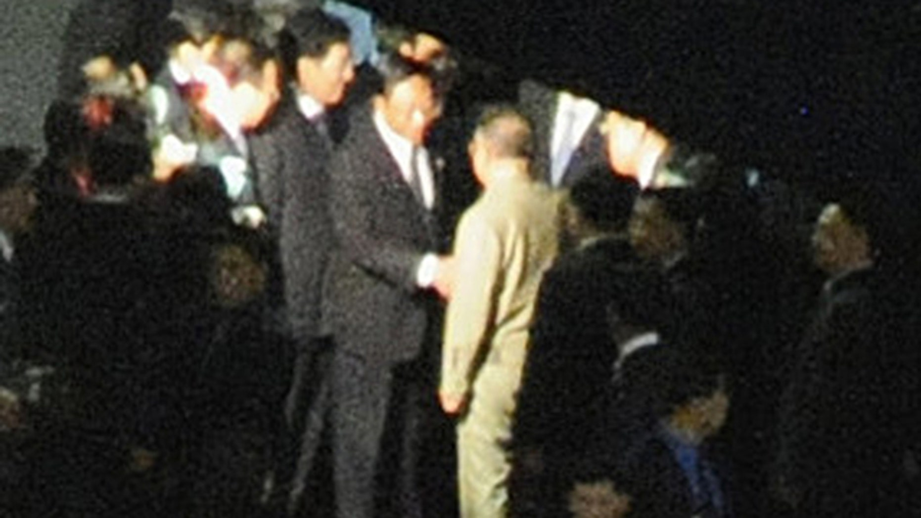 Aug. 28: A man, believed to be North Korean leader Kim Jong Il, center facing away from camera, is greeted at Changchun rail station in Changchun, China.