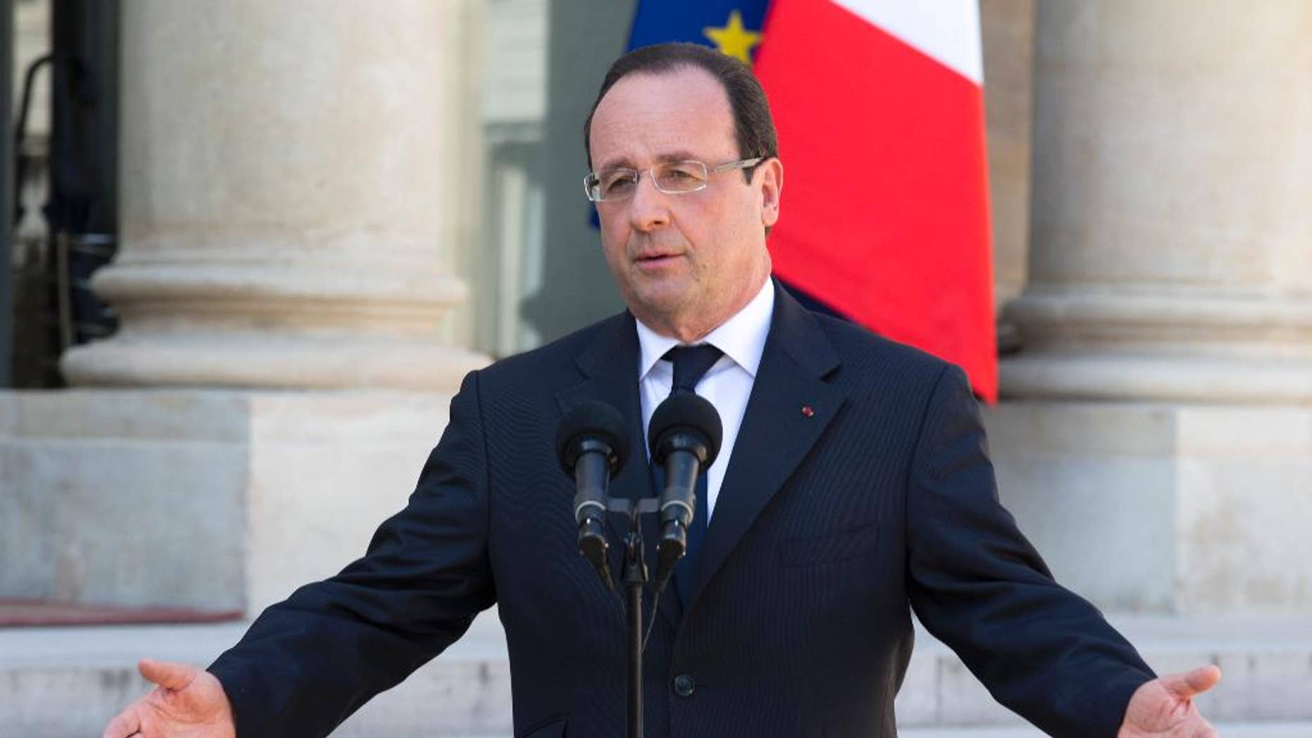 FILE - In this April 24, 2013 file photo, French President Francois Hollande talks to the media after the weekly cabinet meeting in Paris. The most unpopular president in France's modern history, Francois Hollande, is preparing the ground for a potential re-election bid. The 61-year-old Socialist president has not formally announced his intention to run, but more and more signs are emerging that he's in campaign mode. The government set the dates this week for the next election _ two rounds on April 23 and May 7, 2017. (AP Photo/Jacques Brinon, File)