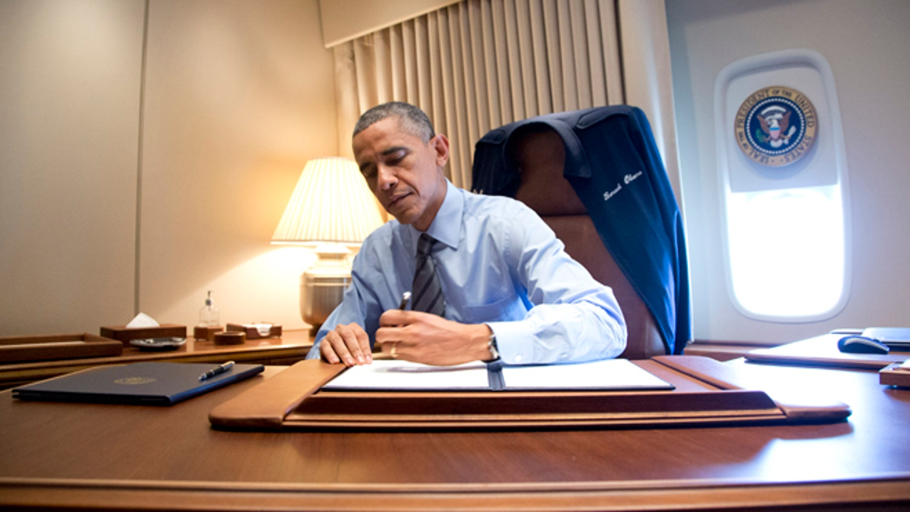 President Obama signed presidential memoranda associated with his actions on immigration on Air Force One.