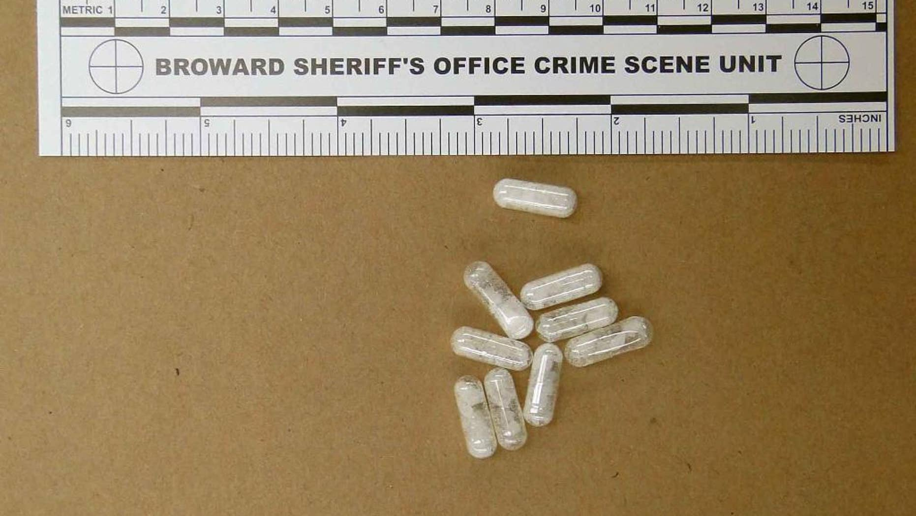 This Feb. 12, 2015 photo made available by the Broward Sheriff's Office, Fla.,  shows confiscated vials of flakka. This emerging drug can alter brain chemistry in such a way that users can't control their thoughts and it can increase adrenalin. (AP Photo/Broward  Sheriff's Office via AP)