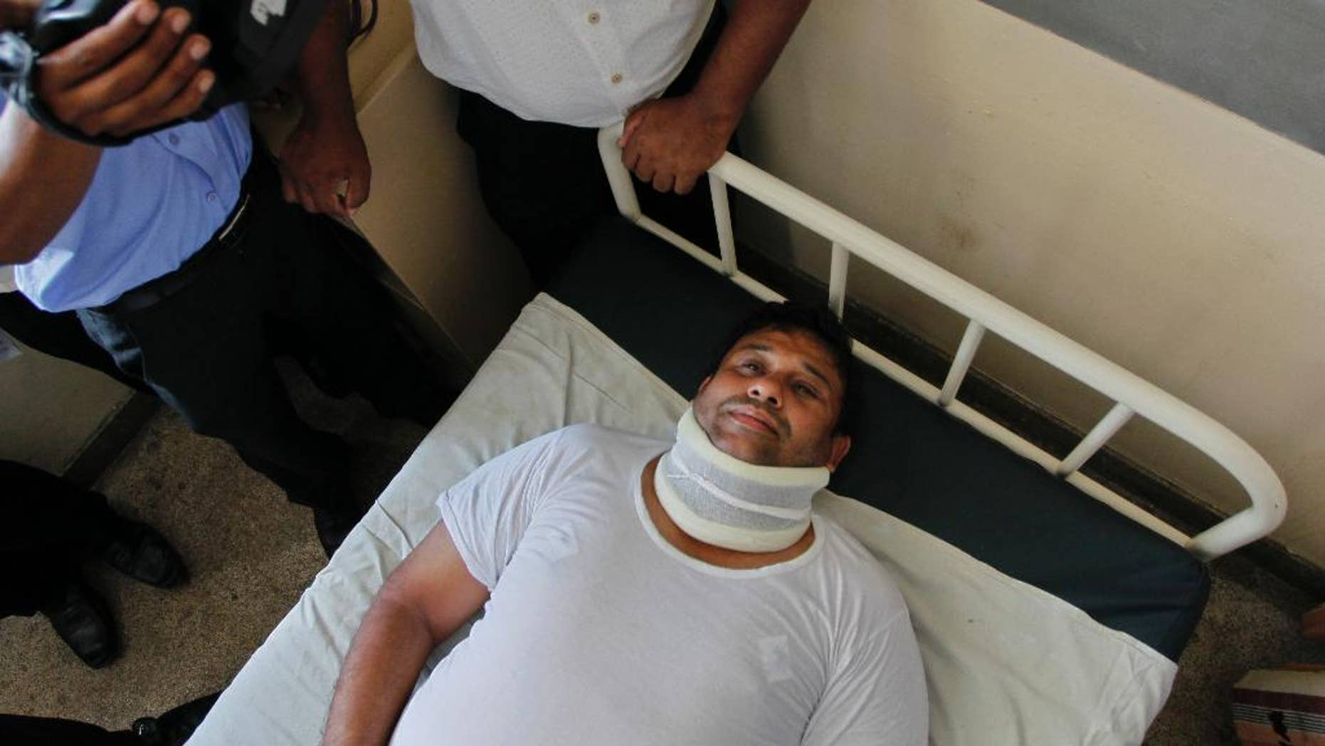 Sri Lanka's ruling United National Party lawmaker Sandith Samarasinghe lies on a hospital bed in Colombo, Sri Lanka, Tuesday, May 3, 2016. Samarasinghe was hospitalized and several lawmakers were injured in fisticuffs inside Sri Lanka's Parliament after a protest over the removal of military security for former President Mahinda Rajapakasa.(AP Photo/Eranga Jayawardena)